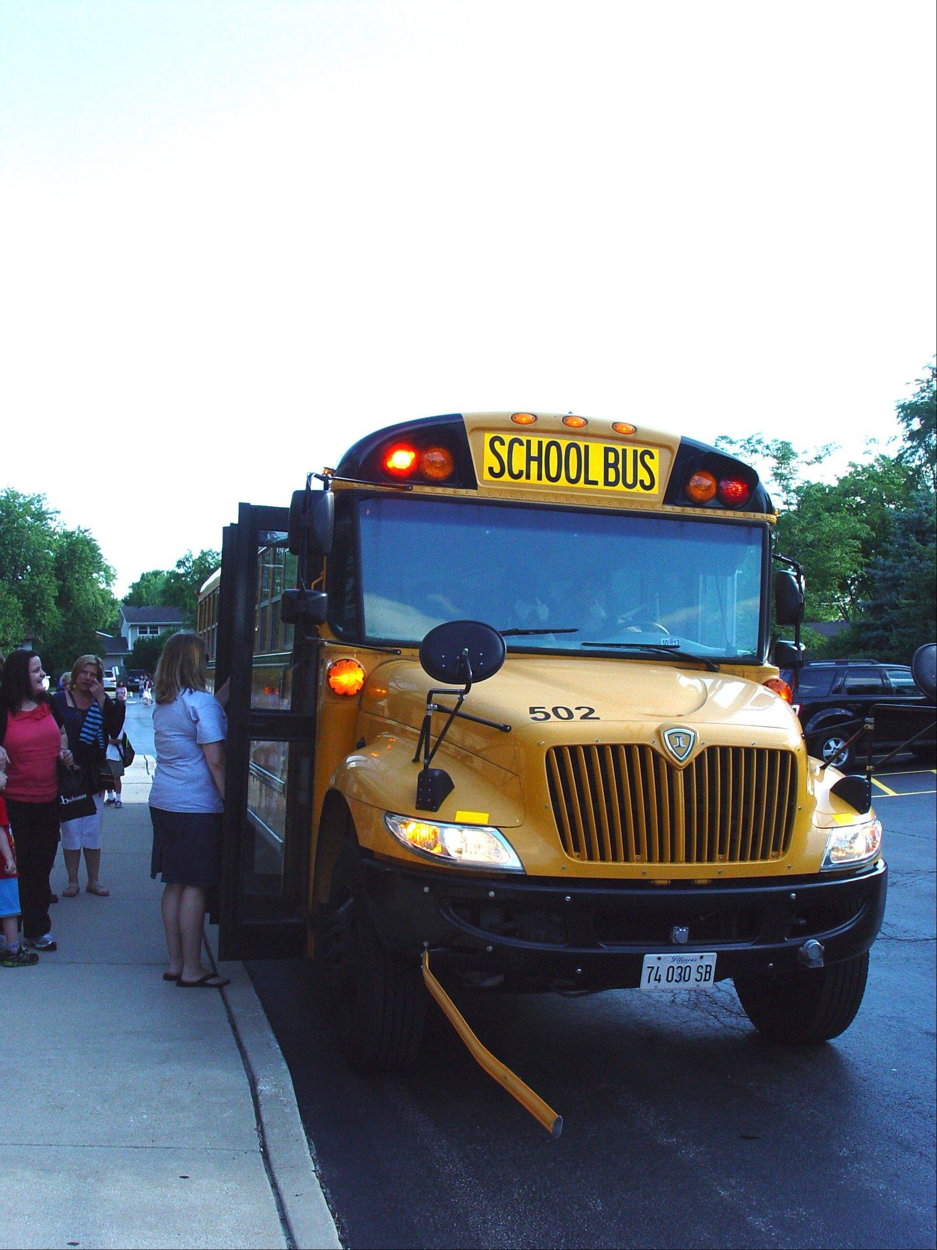Buses arrive for the new school year Wednesday at Ridge Family Center for Learning in Elk Grove Village. The school operates year-round.