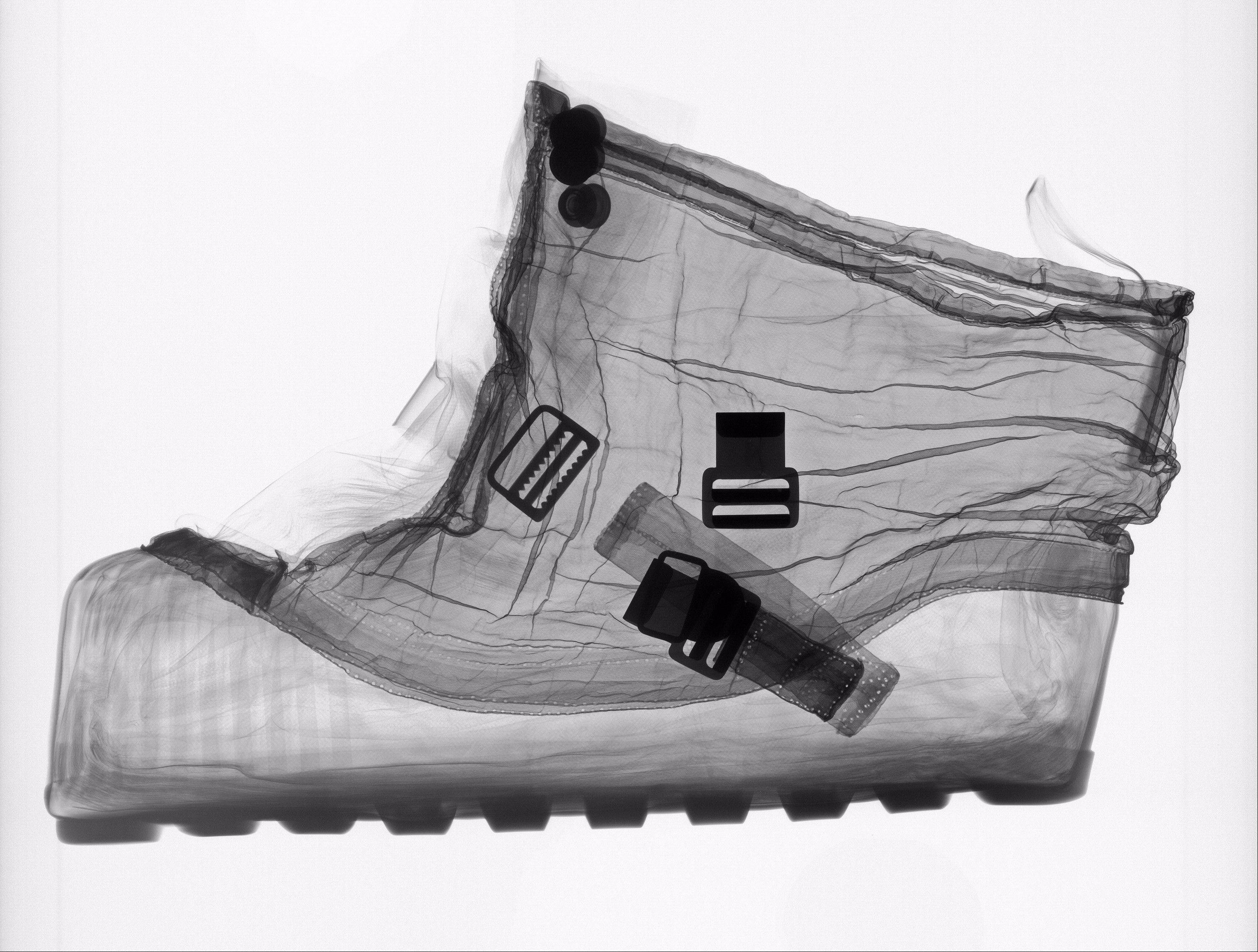 This X-ray of an extravehicular (EV) overshoe that was designed to be worn over the Apollo spacesuit boots while an astronaut was walking on the Moon is part of a new art exhibit at the museum entitled: �Suited for Space,�opening Friday at the Smithsonian National Air and Space Museum.