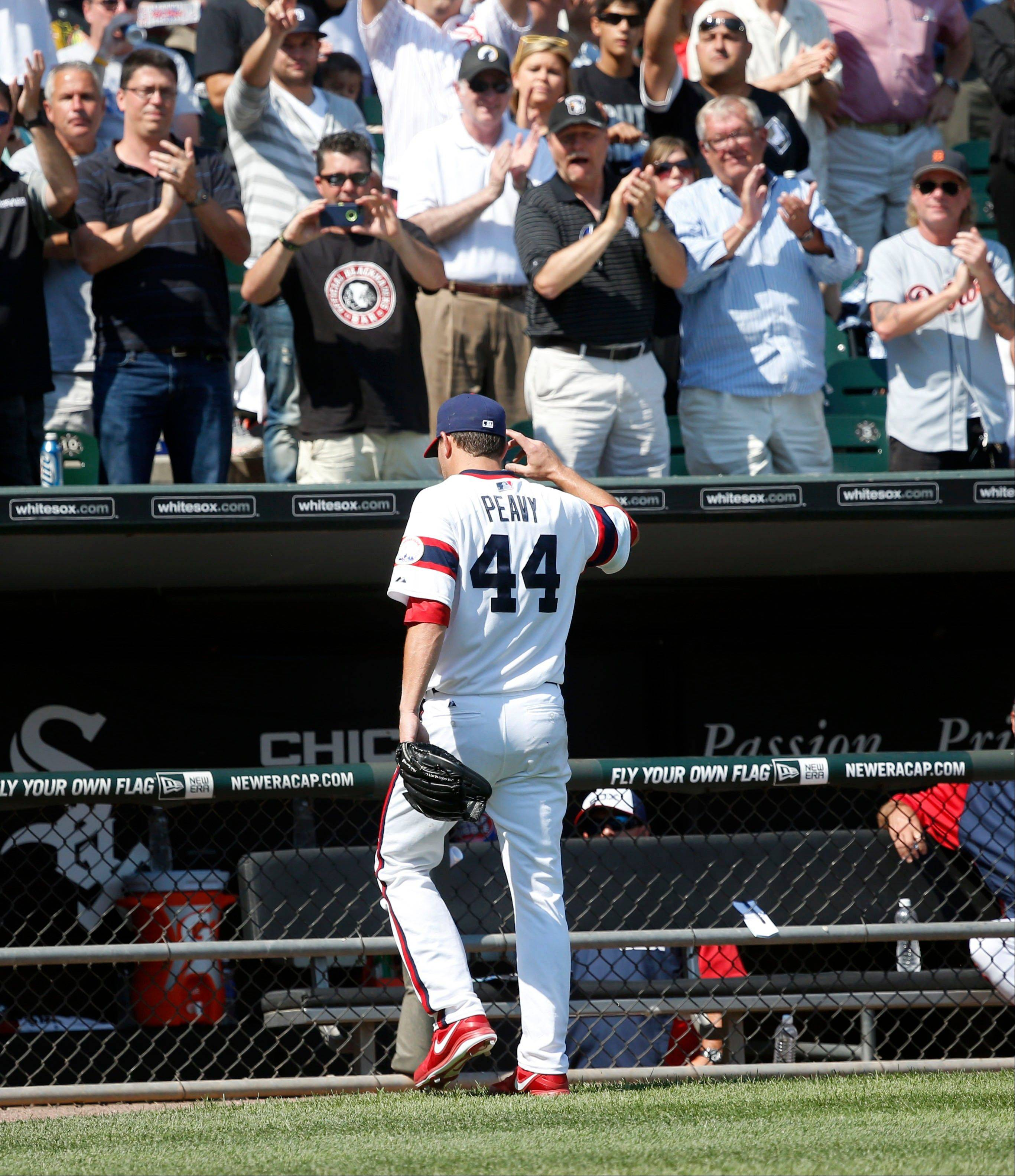 Jake Peavy waves to a cheering crowd as he leaves during the eighth inning of the White Sox� 7-4 victory over Detroit on Thursday at U.S. Cellular Field.