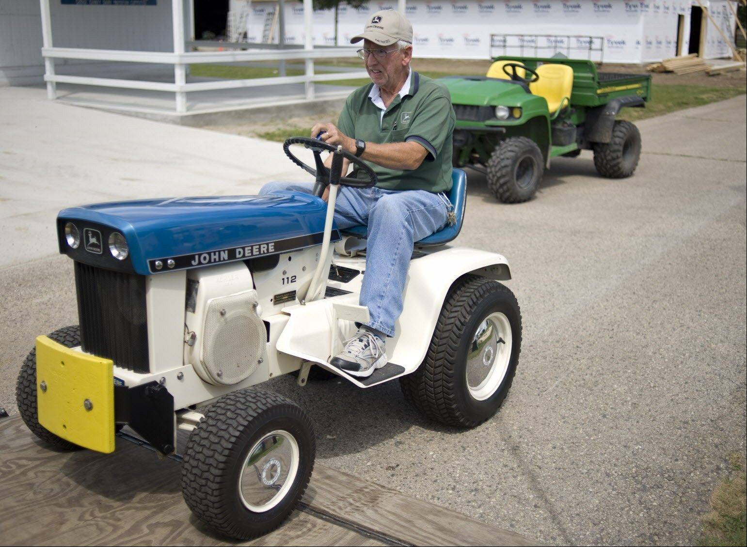 Mark Reading drives a 1963 John Deere 110 model at the Dodge County Fairgrounds Wednesday, July 24, 2013 in Beaver Dam, Wisc.