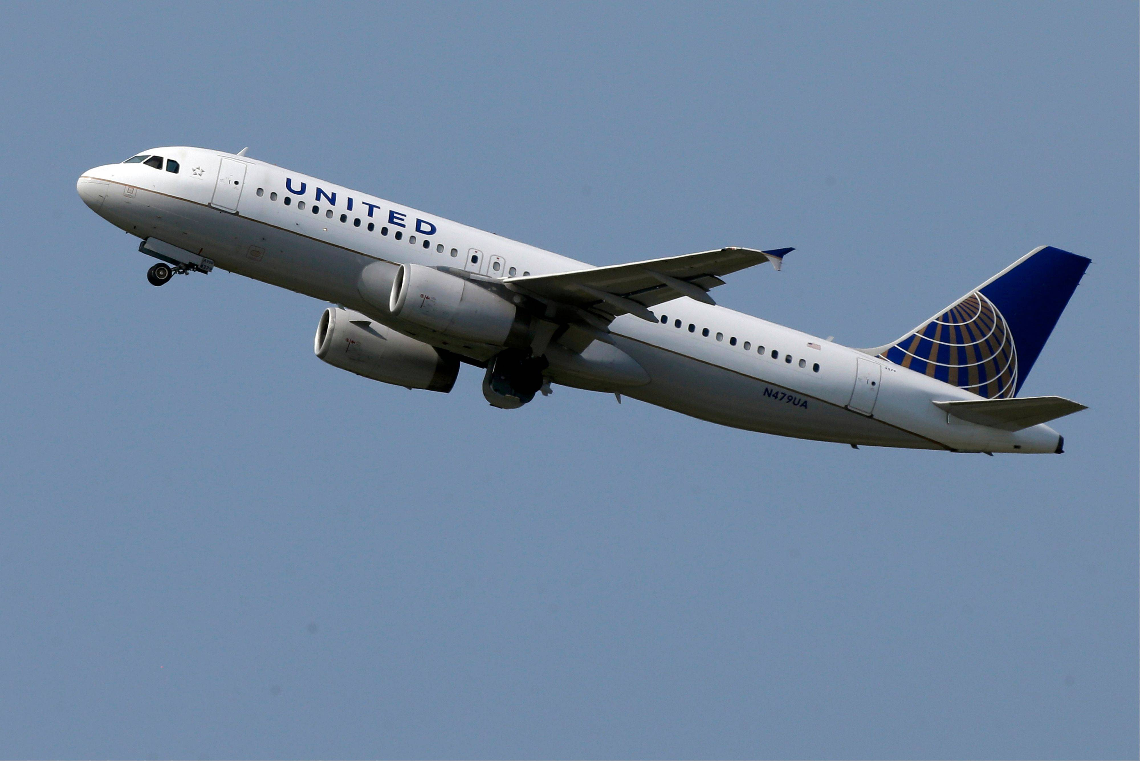The parent of United Airlines says its profit rose 38 percent as it spent less on fuel and slightly boosted fares.