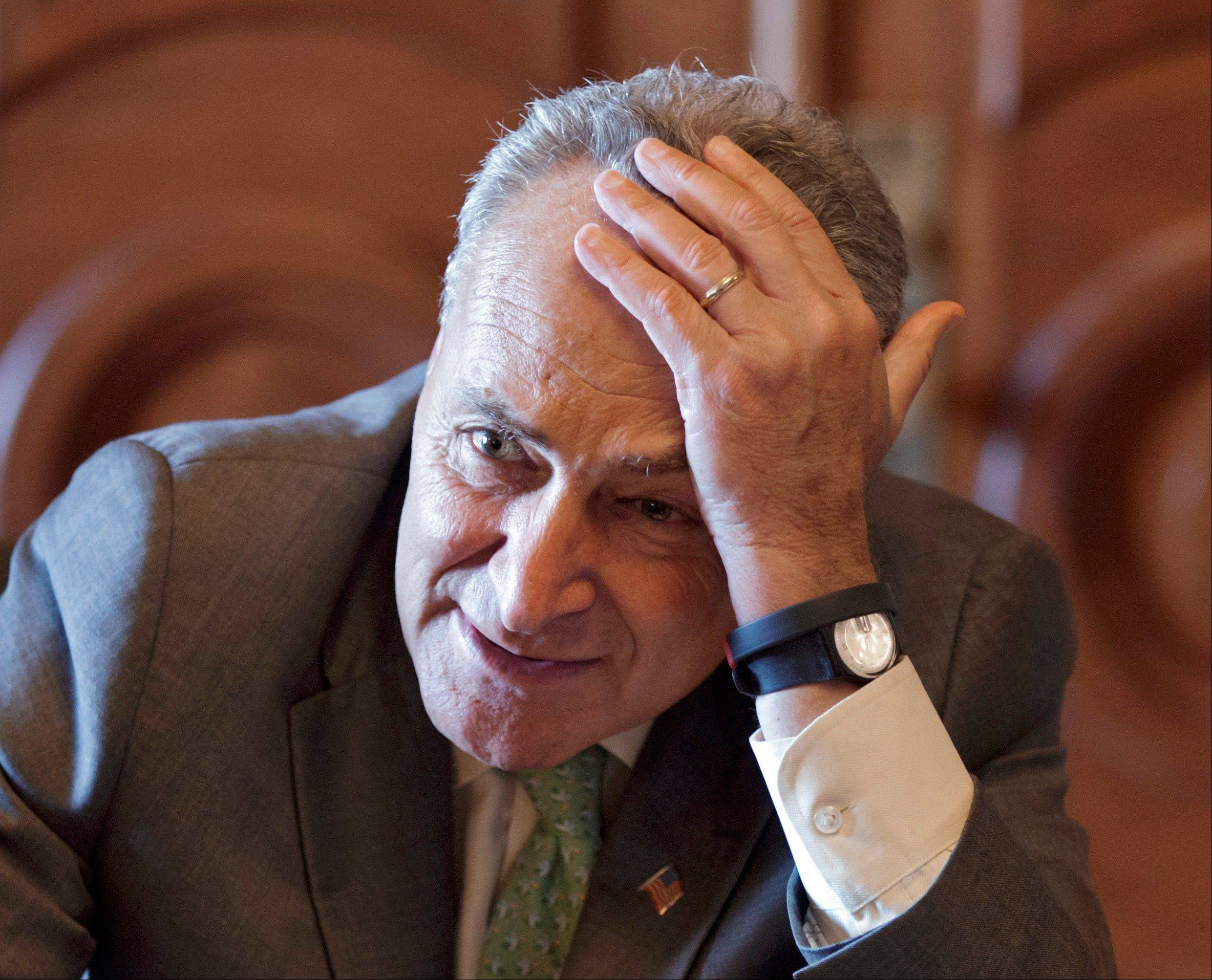 Sen. Chuck Schumer, D-N.Y., has a meeting just off the Senate Chamber just before the final vote on whether to reverse the recent hike in rates for government guaranteed student loans, at the Capitol in Washington, Wednesday.