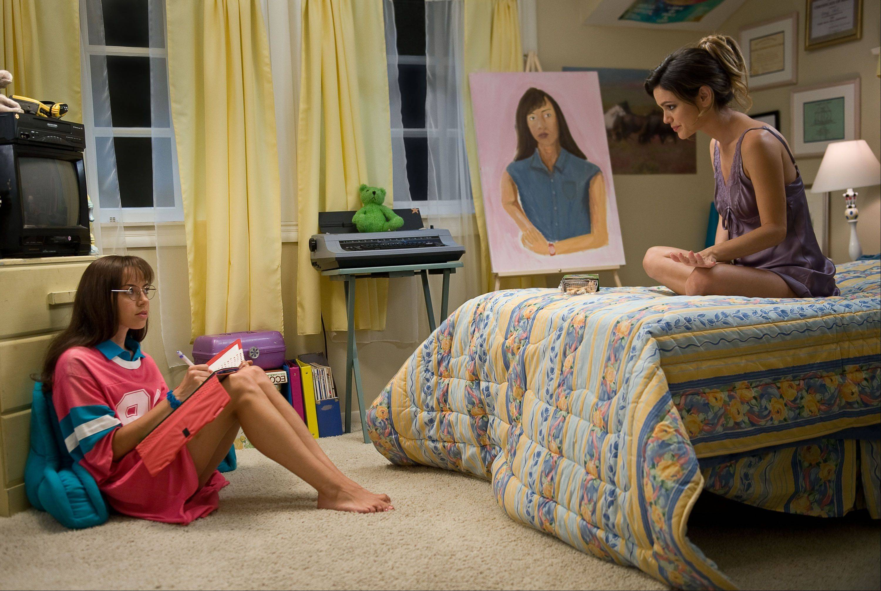 "Brandy (Aubrey Plaza, left) gets advice from her more-experienced sister Amber (Rachel Bilson) in ""The To Do List."""