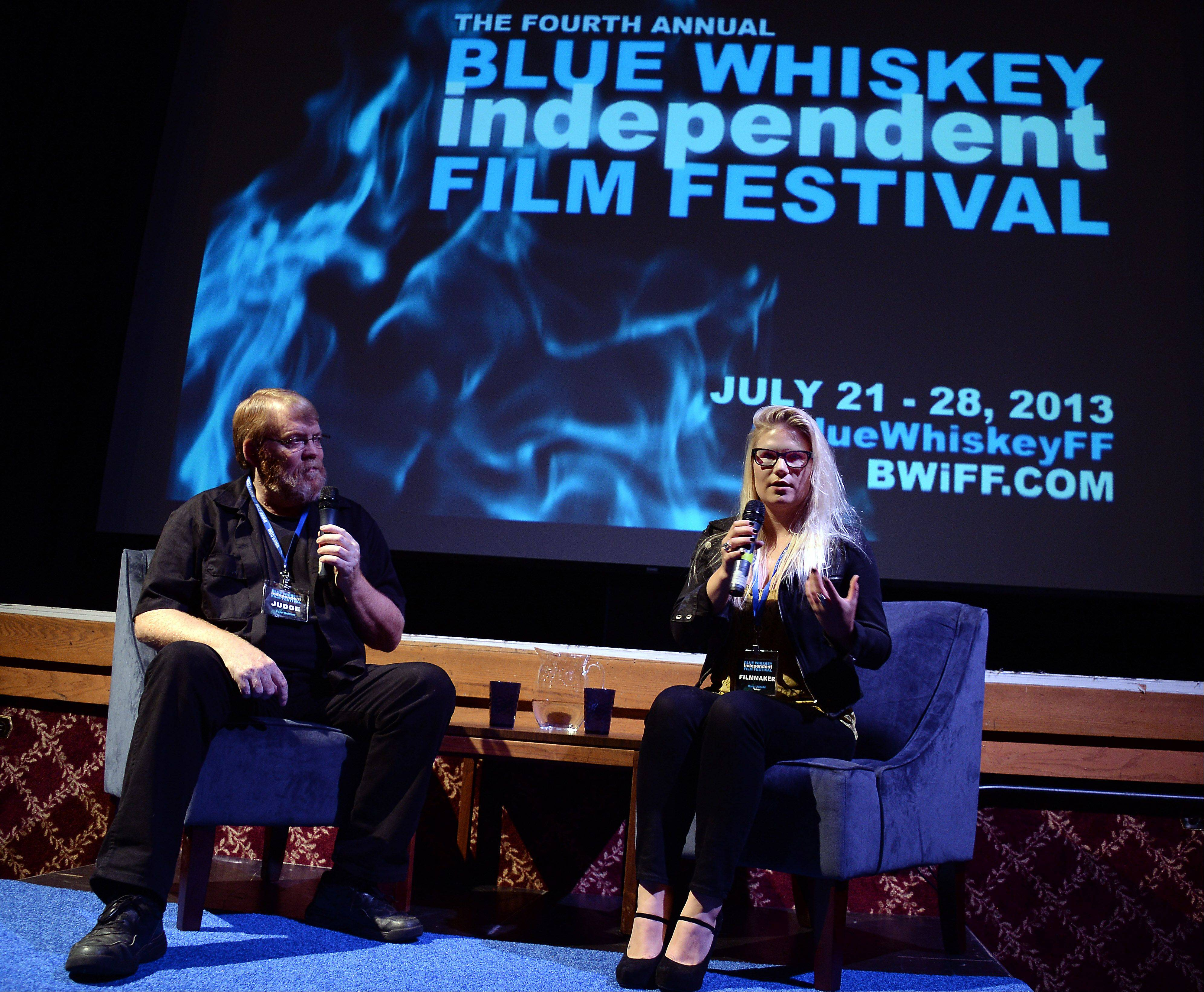 "Judge Pete Guither, assistant dean of the College of Fine Arts at Illinois State University, interviews director Rory Uphold after her 13-minute narrative short film ""Safety"" was viewed at the fourth annual Blue Whiskey Independent Film Festival at Cutting Hall in Palatine on Thursday."