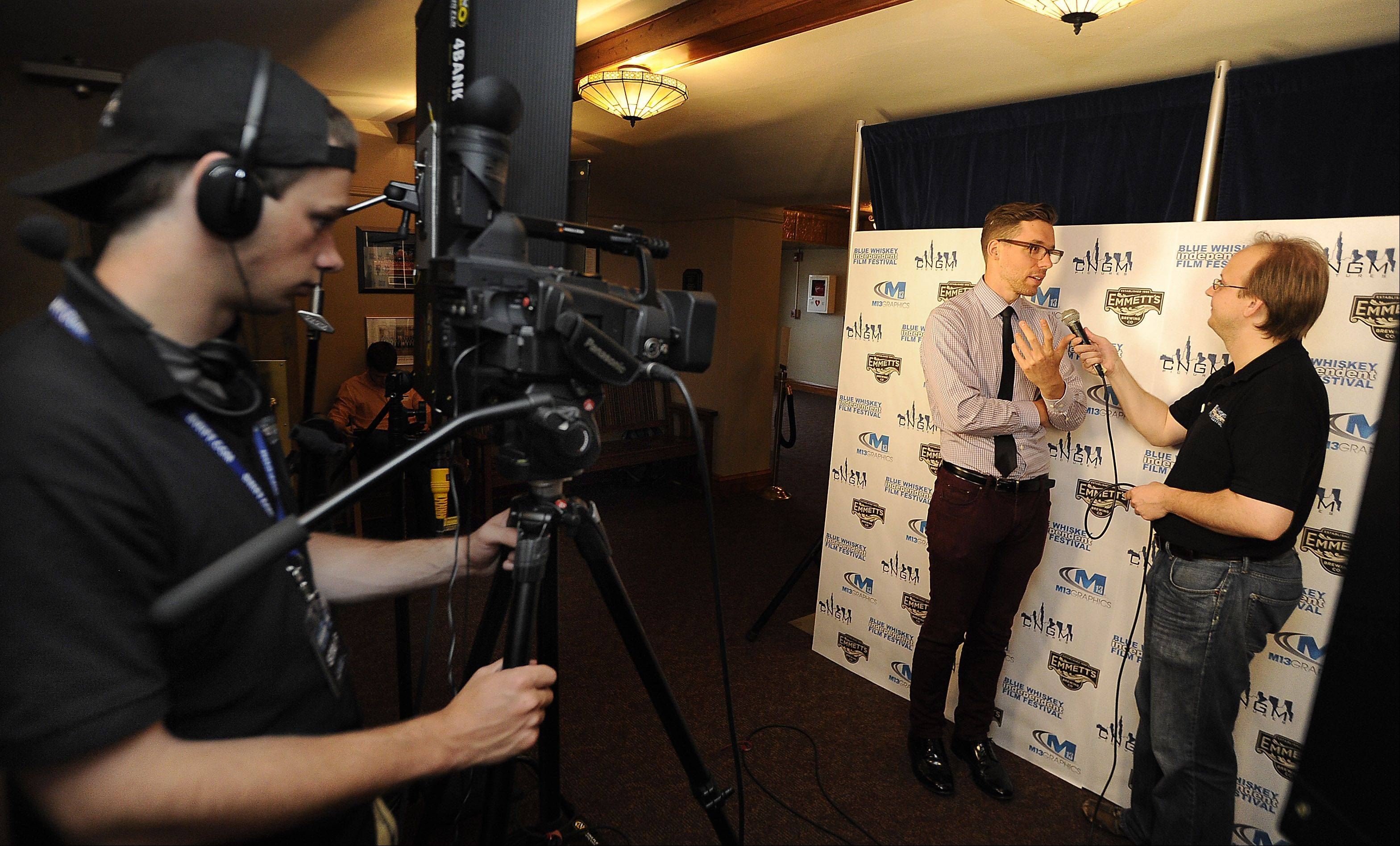 "Master of Ceremonies Jonathan Legat of Des Plaines interviews director Ted Tremper of Chicago whose 23-minute film ""Shrink"" was viewed at the fourth annual Blue Whiskey Independent Film Festival at Cutting Hall in Palatine on Thursday."