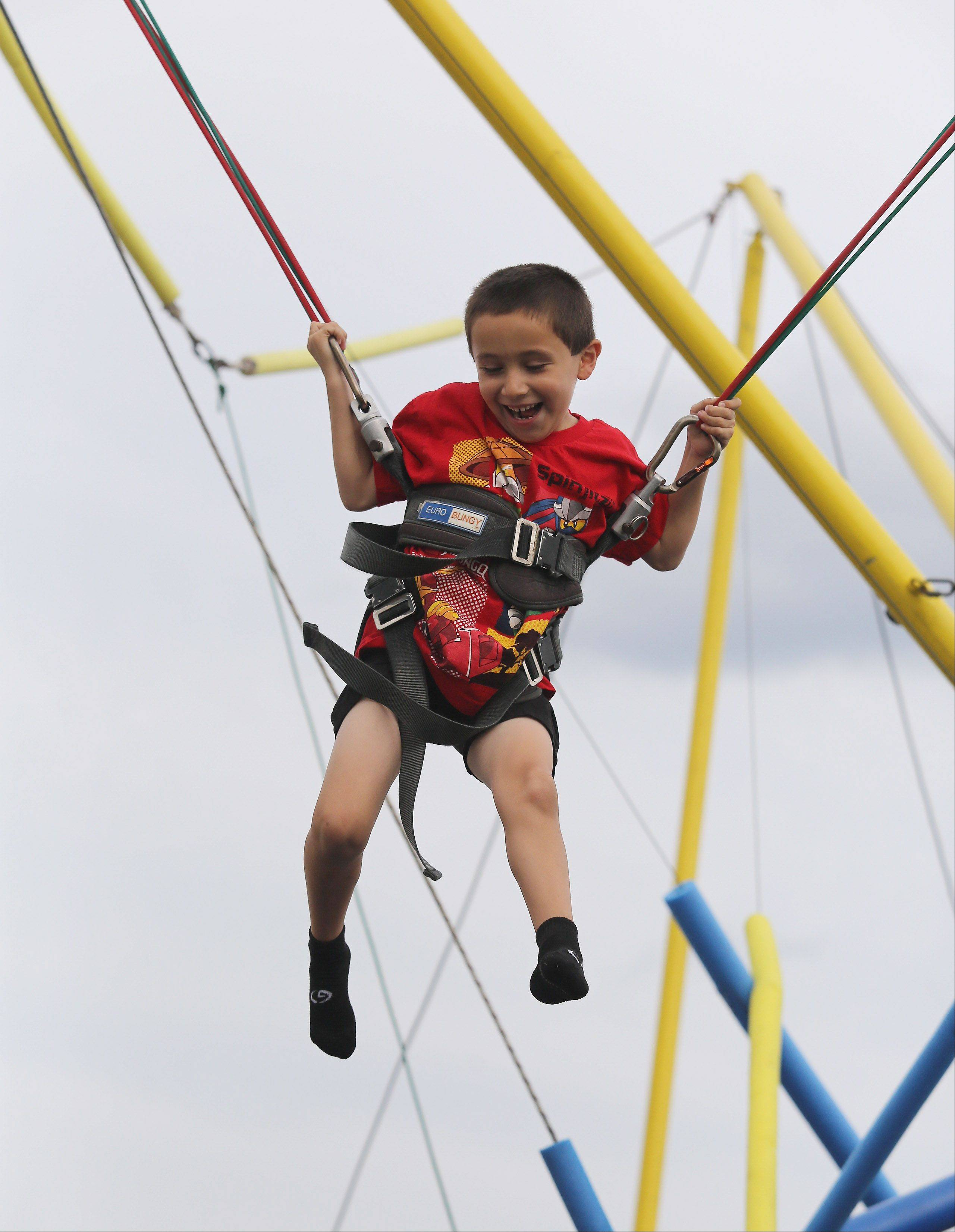 Jacob Eichenbaum, 5, of Vernon Hills plays on the Quad Power Jump during the Lake County Fair Thursday at the Lake County Fairgrounds in Grayslake.