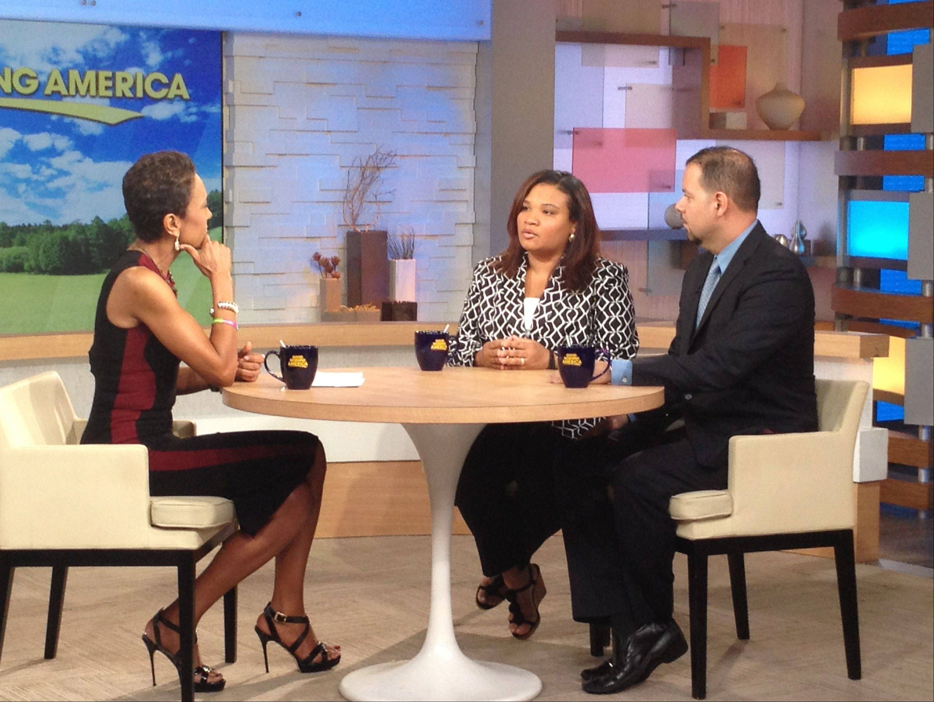 "This image released by ABC shows host Robin Roberts, left, with Juror B29 from the George Zimmerman trial, center, and attorney David Chico on ""Good Morning America,"" in New York on Thursday."