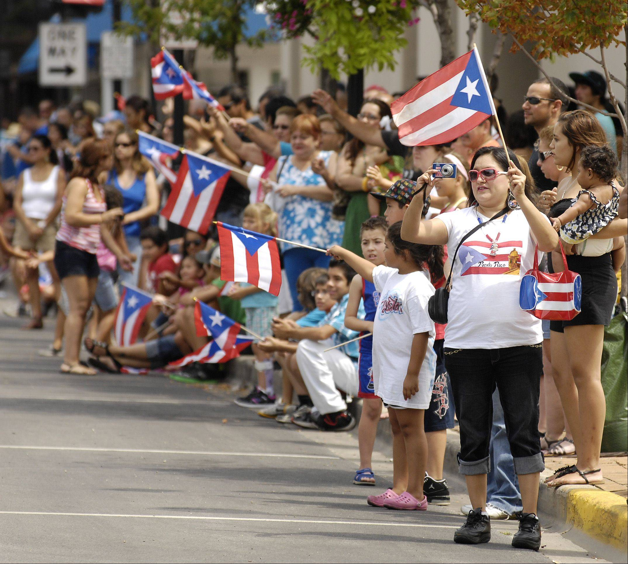 Sunday's parade will be one of the highlights of this year's Puerto Rican Heritage Fest in Aurora. Organizers expect as many as 9,000 people to attend.
