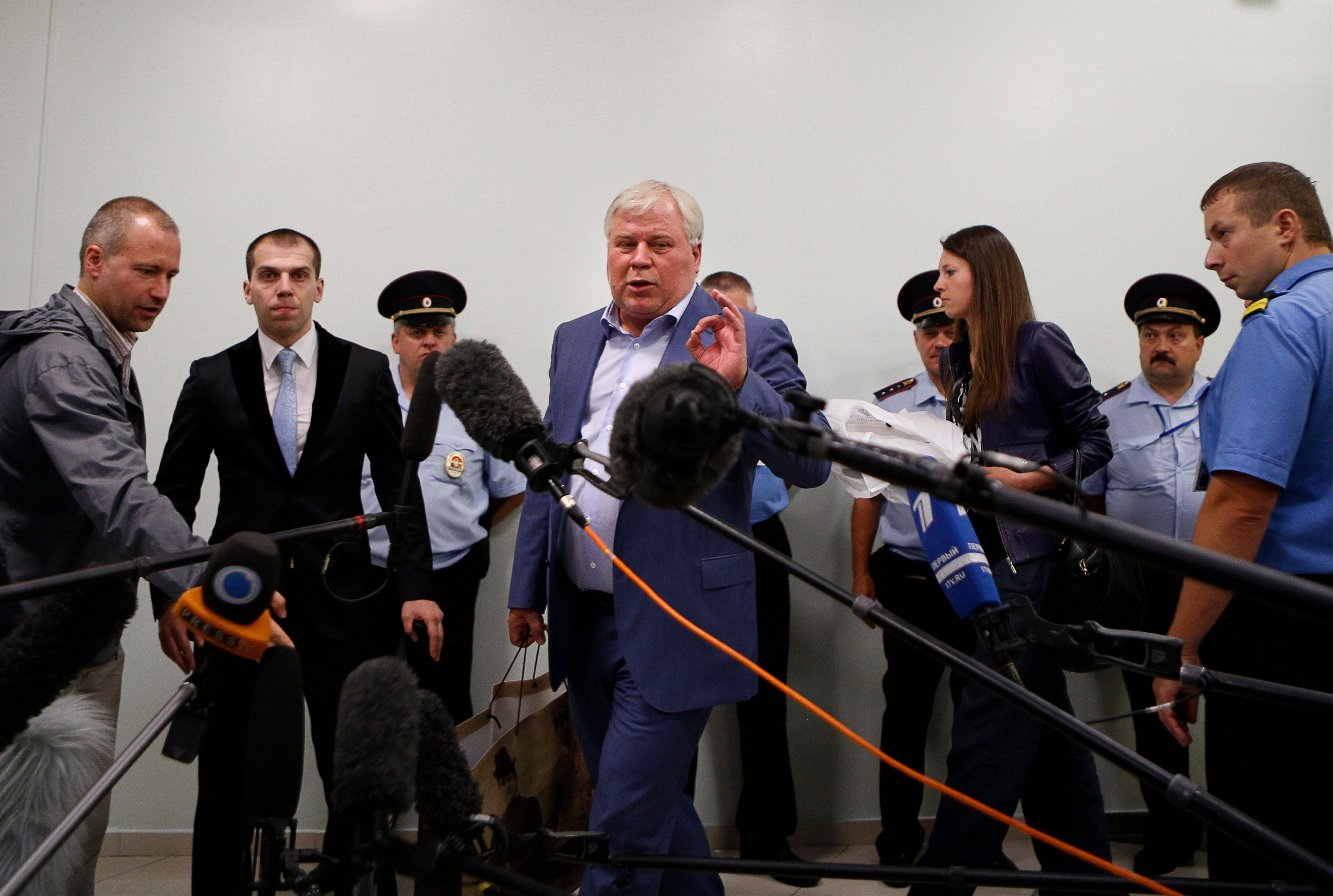 Russian lawyer Anatoly Kucherena speaks to the media after visiting National Security Agency leaker Edward Snowden at Sheremetyevo airport outside Moscow, Russia, Wednesday, July 24, 2013. Congress is advancing sanctions against Russia or any other country offering asylum to Snowden.