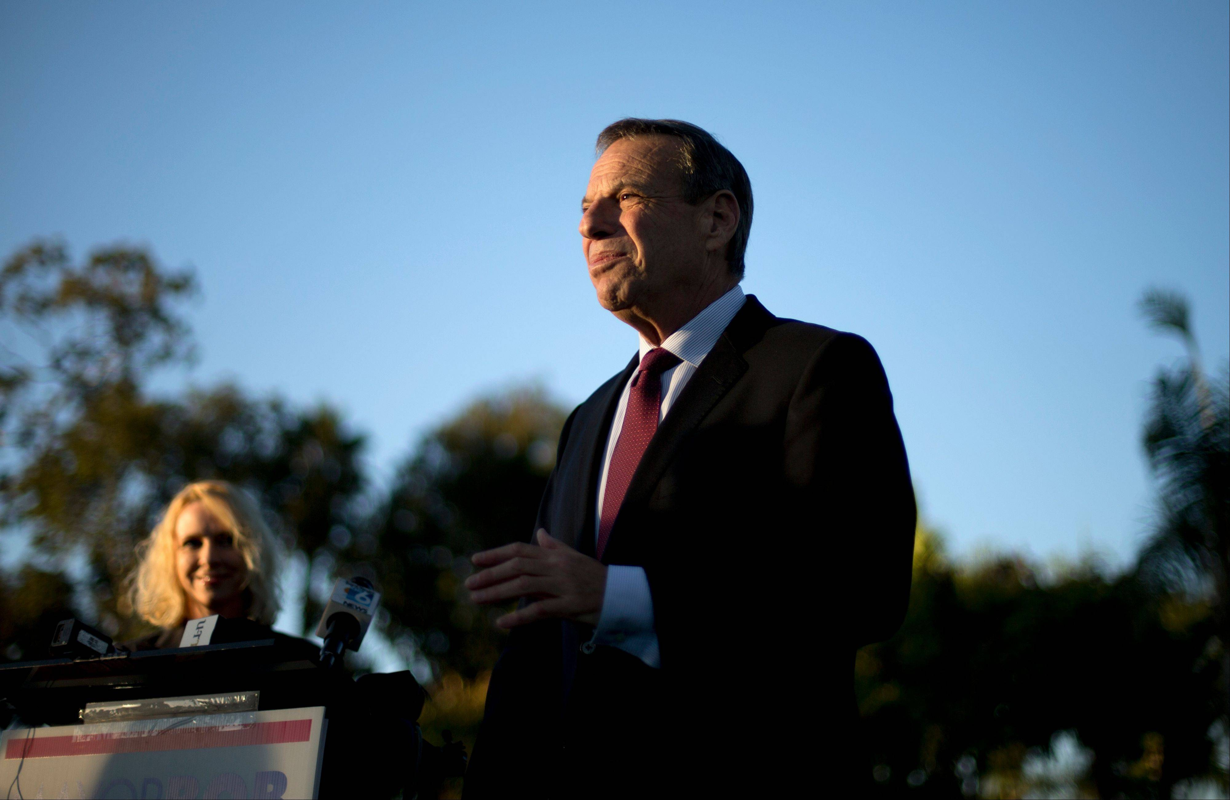 In this Nov. 7, 2012 file photo, San Diego Mayor Bob Filner, right, speaks alongside his then-fiancee Bronwyn Ingram, left, during a news conference at a park in San Diego. It has been anything but normal for San Diego and its first Democratic leader in 20 years since prominent former supporters all