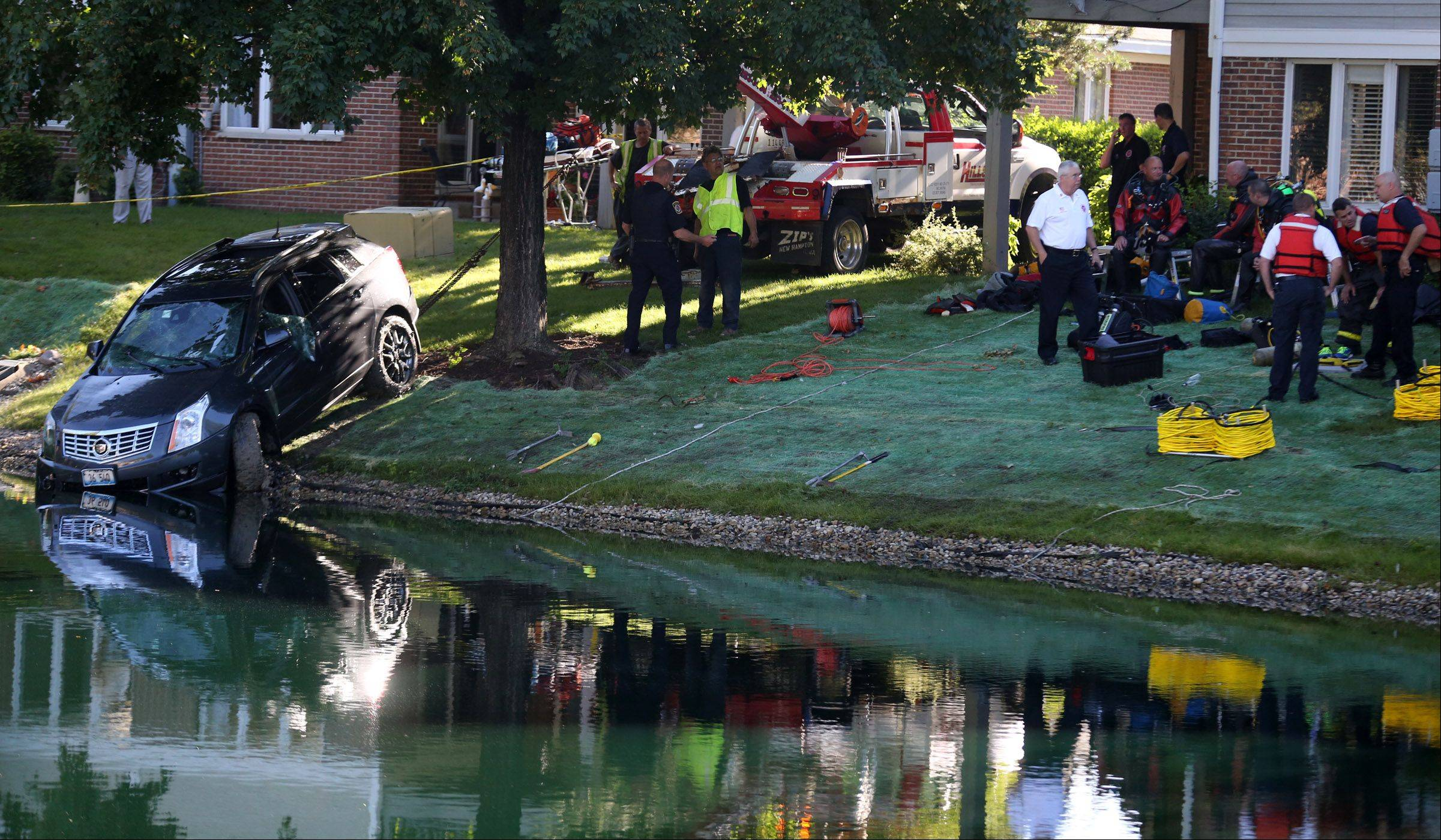 A man was pulled from a vehicle in a pond Thursday morning in the 1500 block of Courtland Drive in Arlington Heights.
