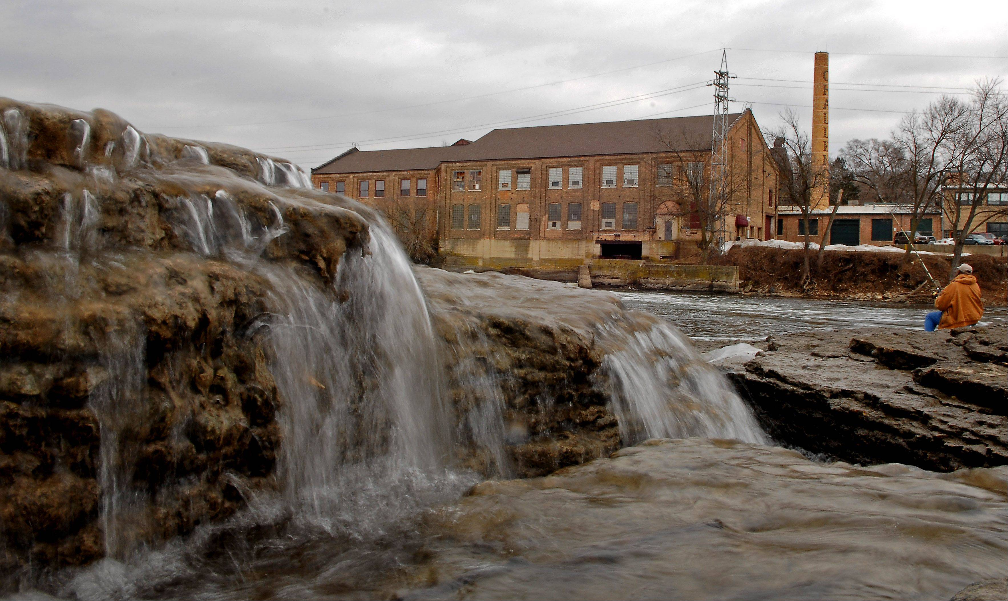 Water flows freely with no ice near the dam on the Fox River in Batavia during an unusually warm winter. To the east is the former Challenge Wind Mill and Feed Co. complex, a remnant of the town's former focus on the river as a supplier of power.