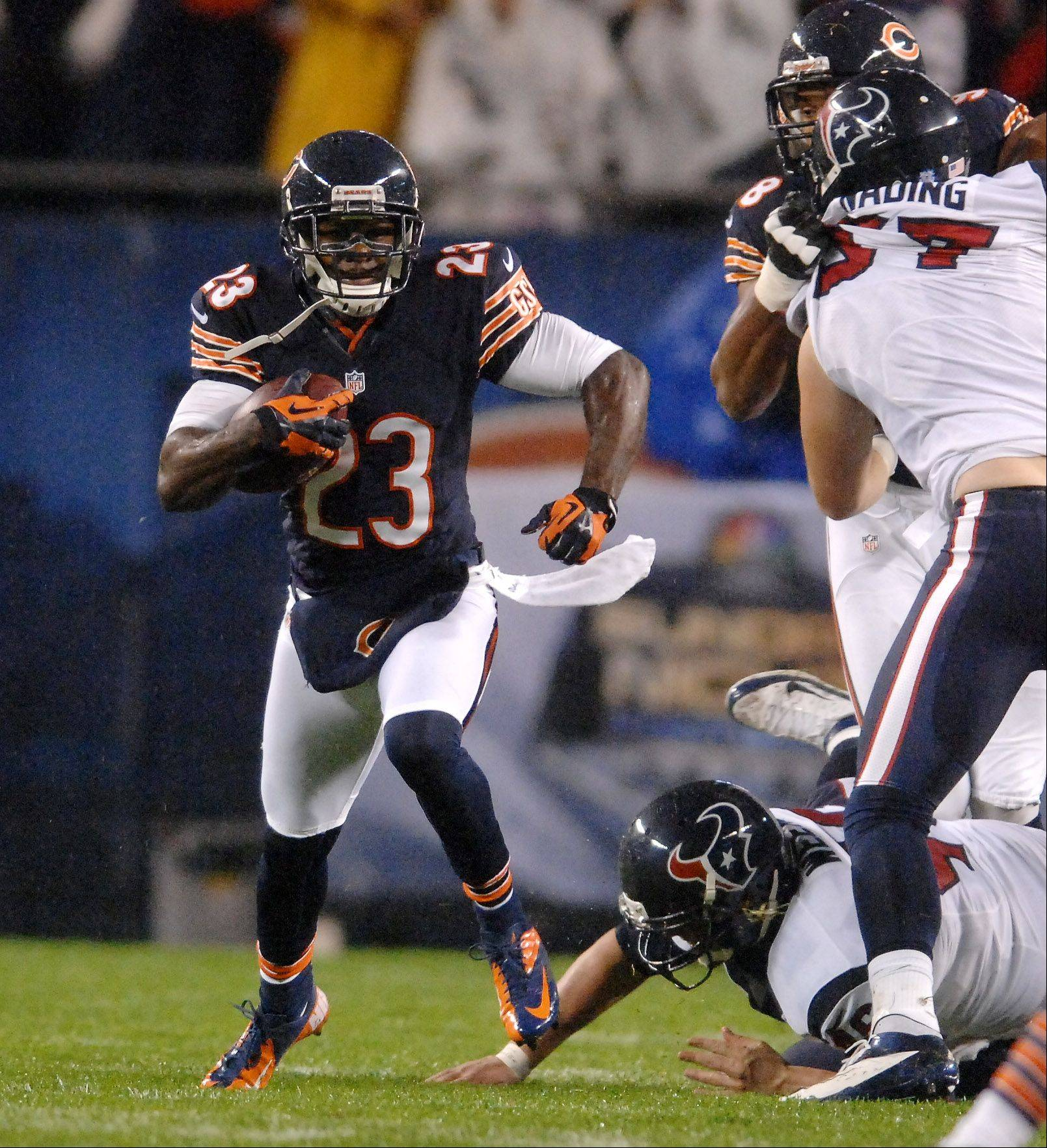 Bears wide receiver Devin Hester (23) breaks a tackle on a punt return during Sunday's game at Soldier Field in Chicago.