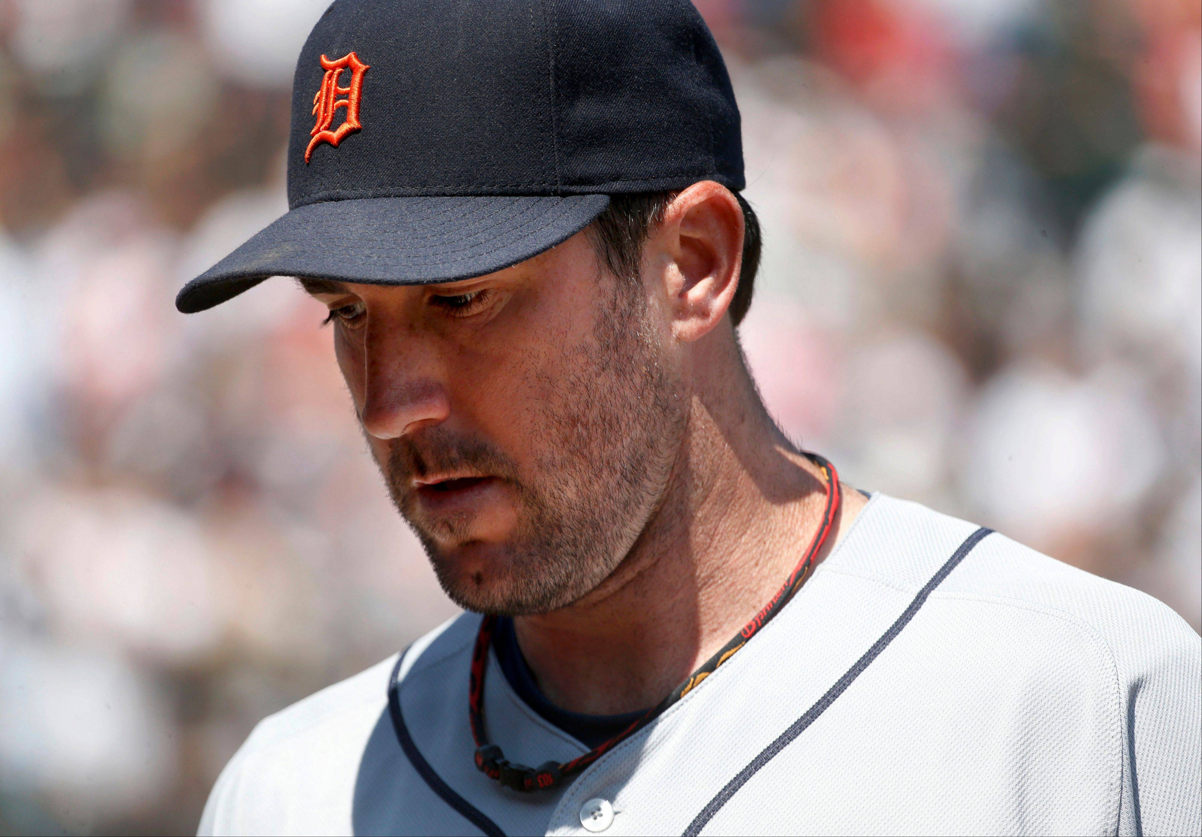 Detroit Tigers starting pitcher Justin Verlander heads into the dugout after giving up four runs to the Chicago White Sox in the fourth inning of a baseball game Thursday, July 25, 2013, in Chicago.