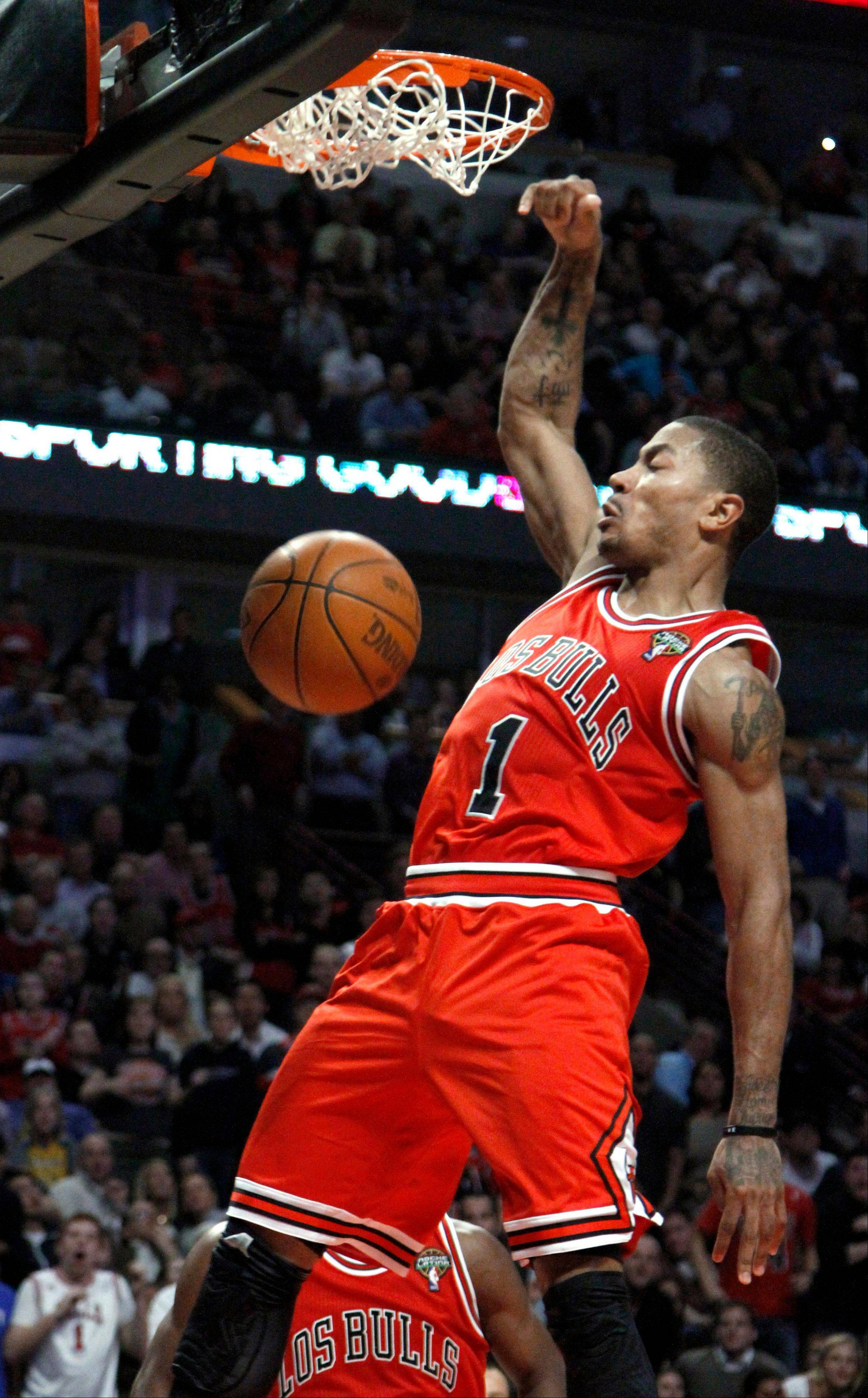 Chicago Bulls guard Derrick Rose dunks during the second half of an NBA basketball game against the New York Knicks, Monday, March 12, 2012, in Chicago. The Bulls won 104-99 with Rose scoring 32 points.