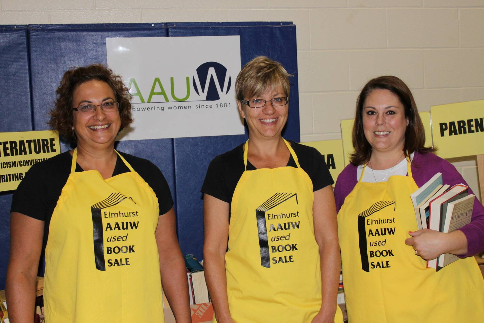 "Members of AAUW (Lauren Pittelli, Cindy Grau and Susan Szymanski) get ready for the Annual Used Book Sale on August 1-4 at Jackson Elementary School in Elmhurst (925 Swain).  ""We estimate there will be around 25,000 books to choose from,"" Szymanski reports, ""as well as CDs, DVDs, LPs and even sheet music."""