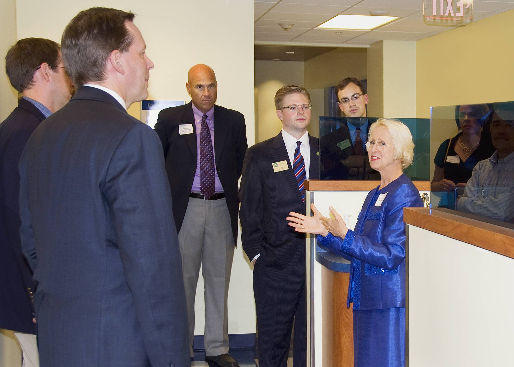 Kathleen H. Goeppinger, Ph.D., President and Chief Executive Officer of Midwestern University, leads a tour of the new Dental Institute at Midwestern University's Multispecialty Clinic.
