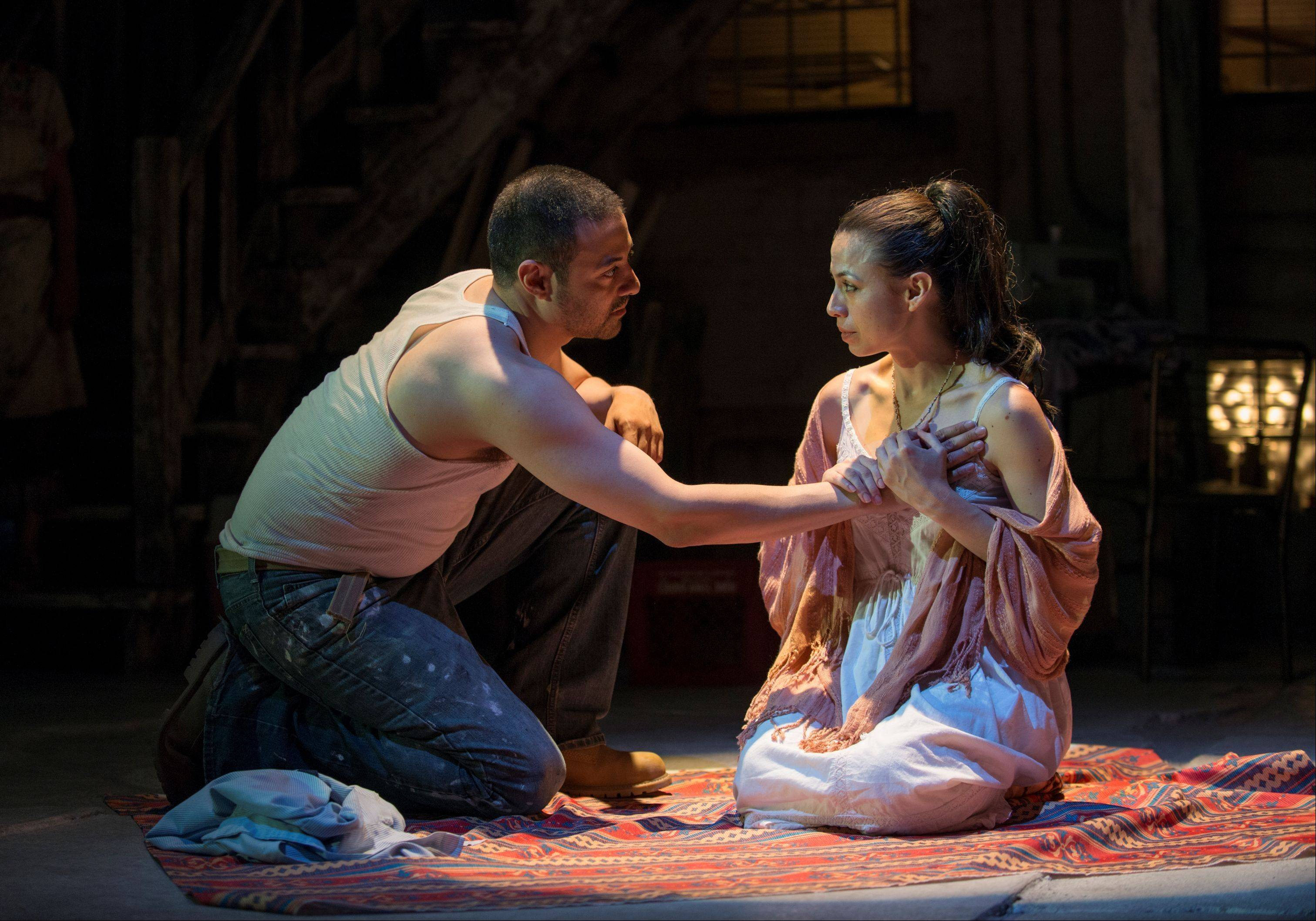 "Mexican immigrants Jason (Juan Francisco Villa) and Medea (Sandra Delgado) try to make a better life for themselves and their son in Chicago's Pilsen neighborhood in Luis Alfaro's ""Mojada,"" in its world premiere at Victory Gardens Theater."