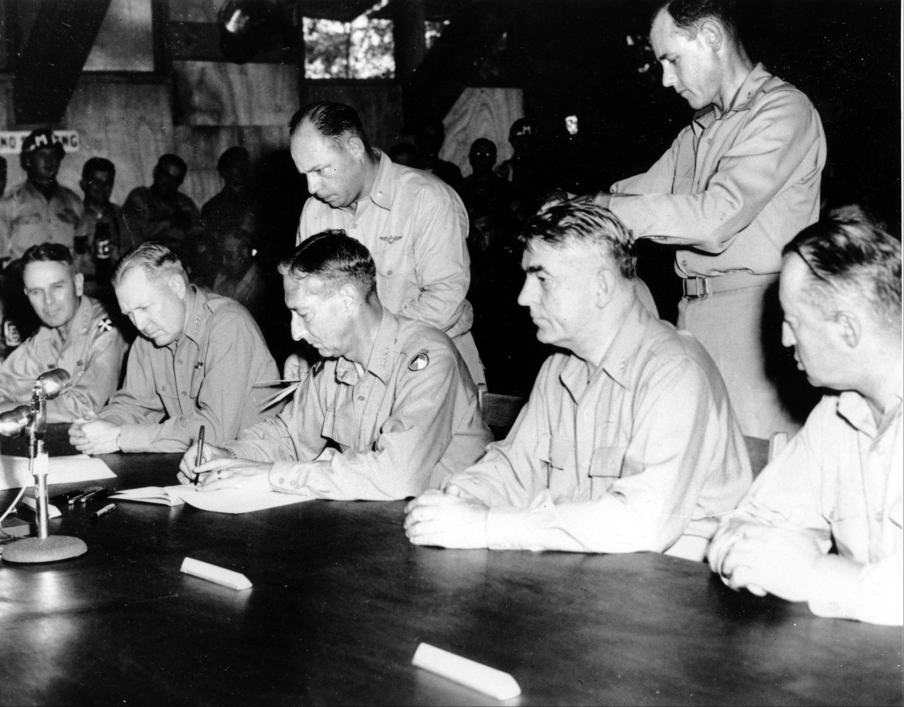 Commander-in-chief, United Nations Command, and U.S. Army Gen. Mark Clark signs the Military Armistice agreement at a base camp at Munsan-ni, Korea.