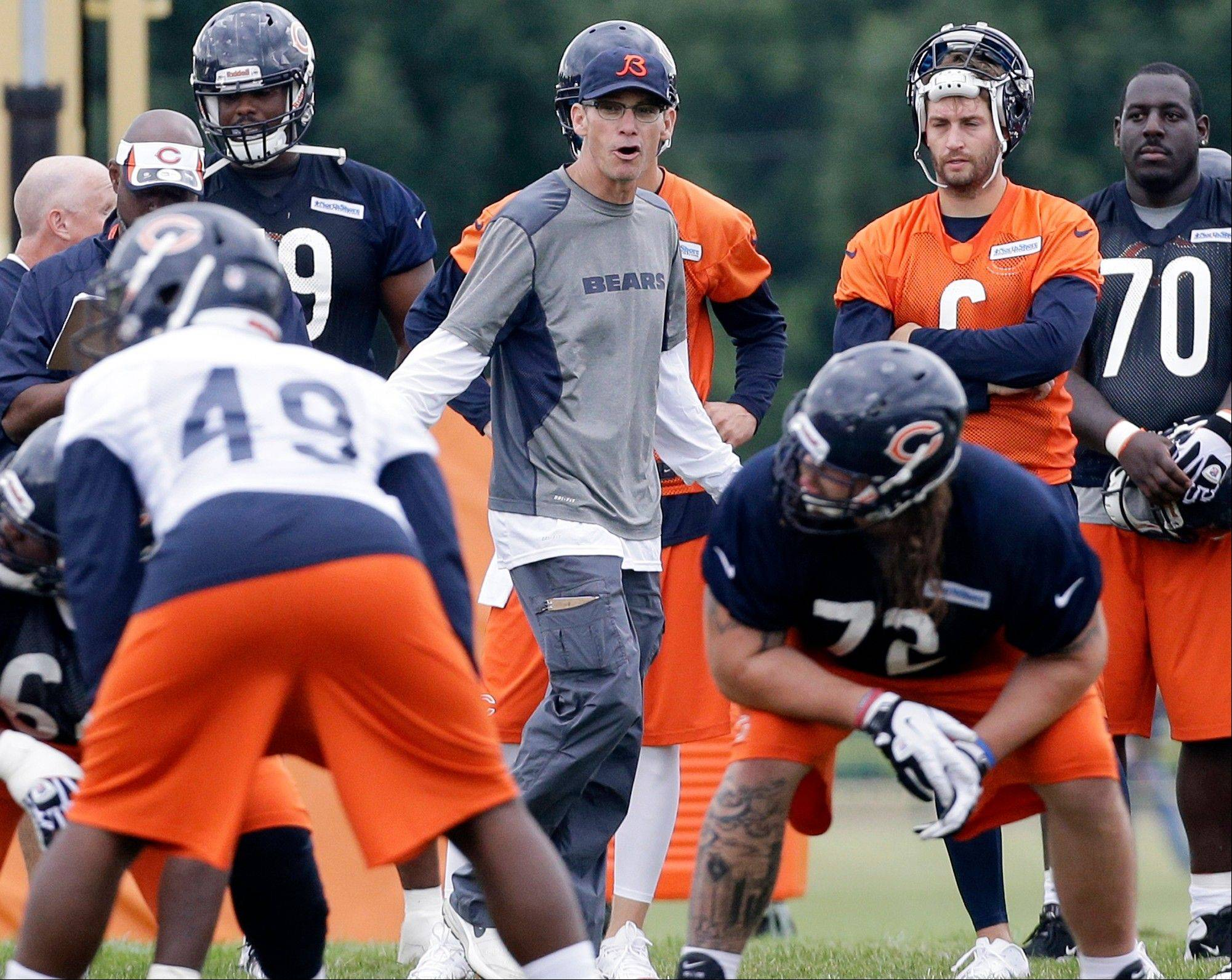 Chicago Bears head coach Marc Trestman, center, watches his team.