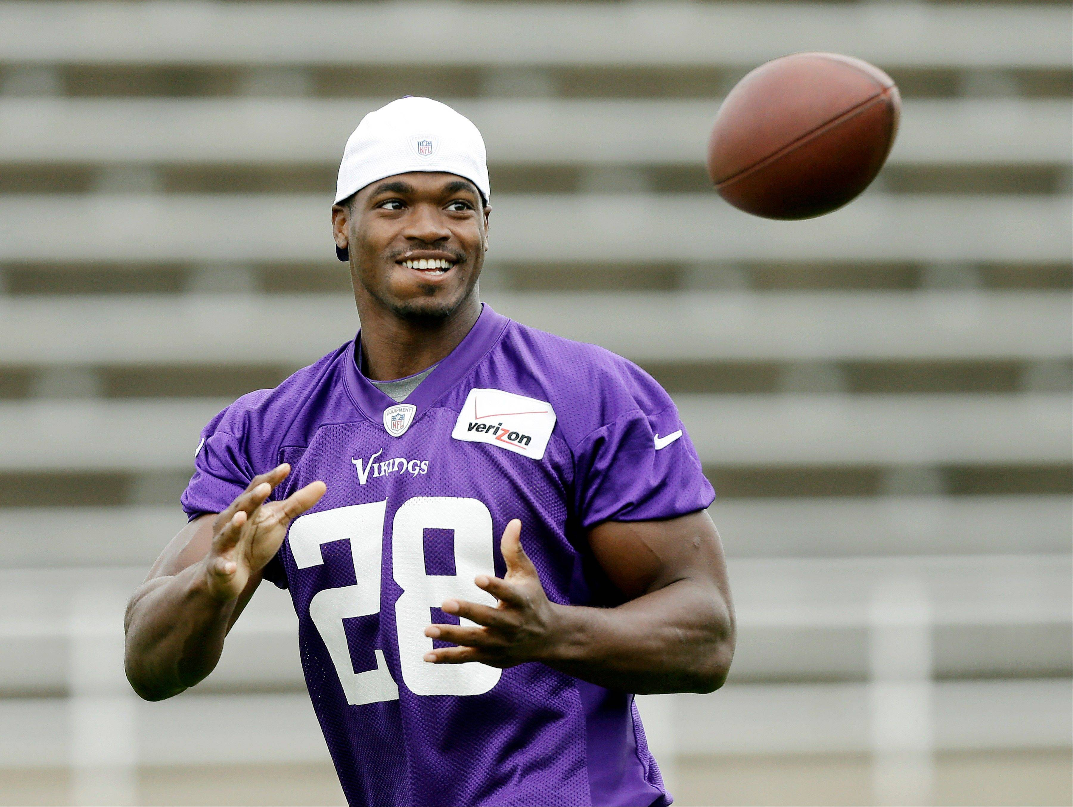 Minnesota Vikings running back Adrian Peterson, here catching the ball during NFL training camp Friday in Mankato, Minn., says he is eager for the league to approve testing for human growth hormone.