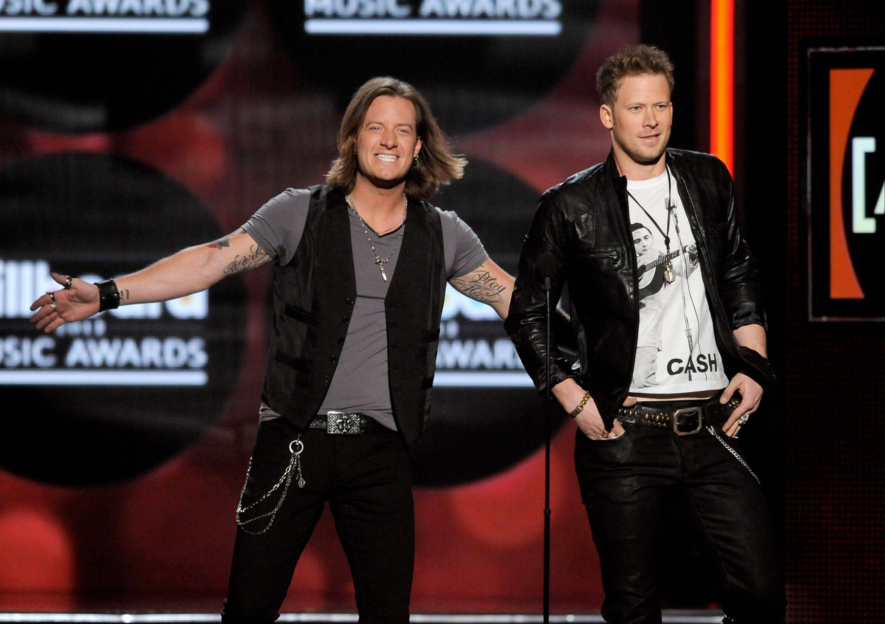 Tyler Hubbard, left, and Brian Kelley, of Florida Georgia Line, appear onstage at the Billboard Music Awards in May. The duo will be performing Halloween night at the Sears Centre Arena in Hoffman Estates.