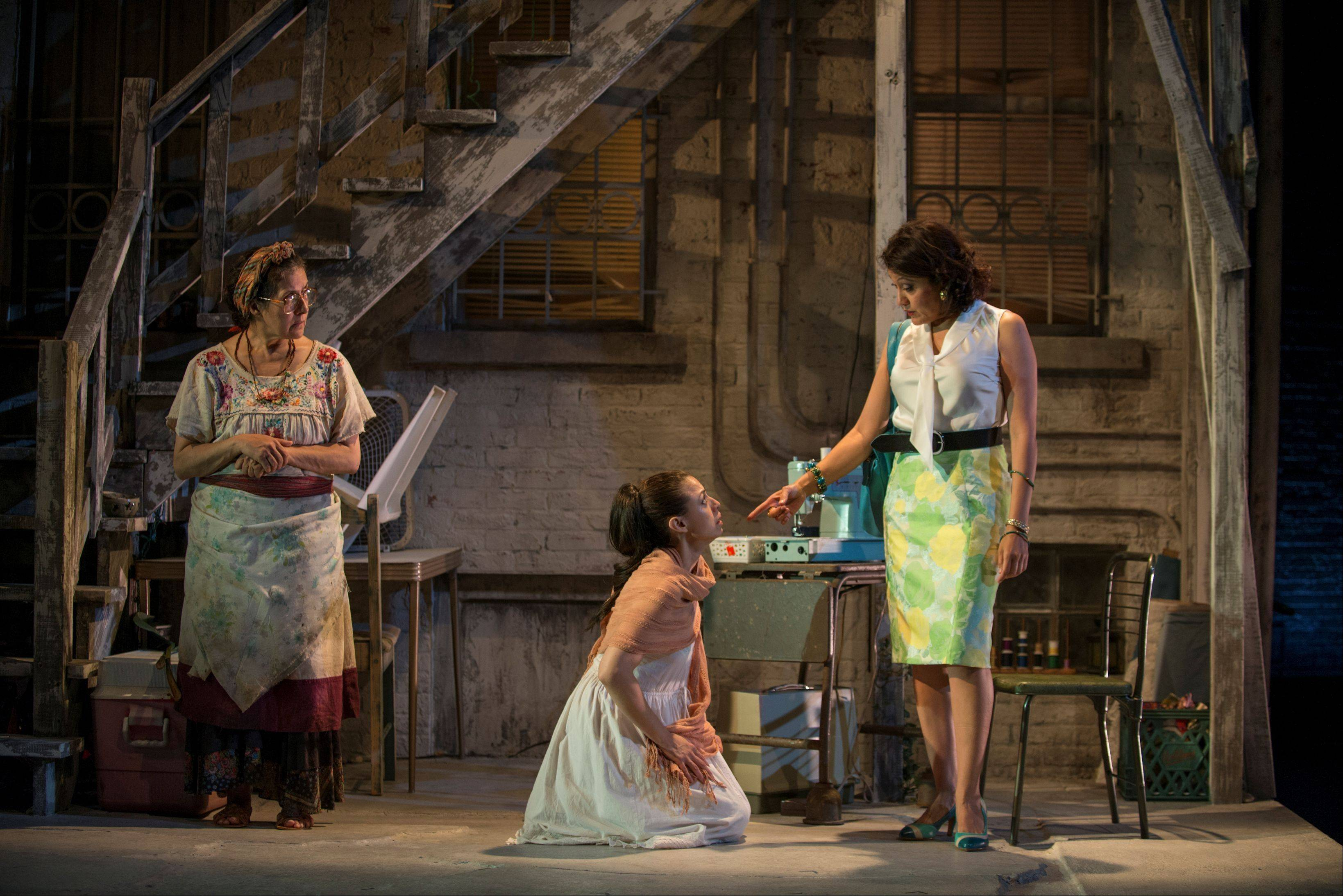 "Landlord Armida (Sandra Marquez), right, threatens Medea (Sanda Delgado), center, and her nanny/servant Tita (Socorro Santiago) in Victory Gardens Theater's world premiere of ""Mojada"" Luis Alfaro's latest Greek myth-inspired drama."