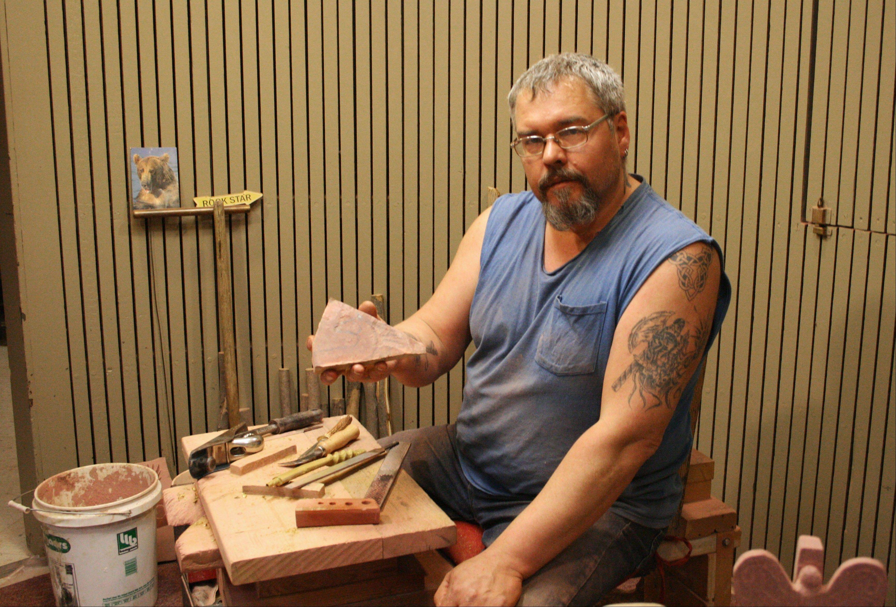 Fourth-generation pipe maker Travis Erickson holds a piece of catlinite -- a sheet of stone -- that he will carve into a traditional Native American pipe at Pipestone National Monument in Minnesota. The pipes are works of art as well as ceremonial objects.
