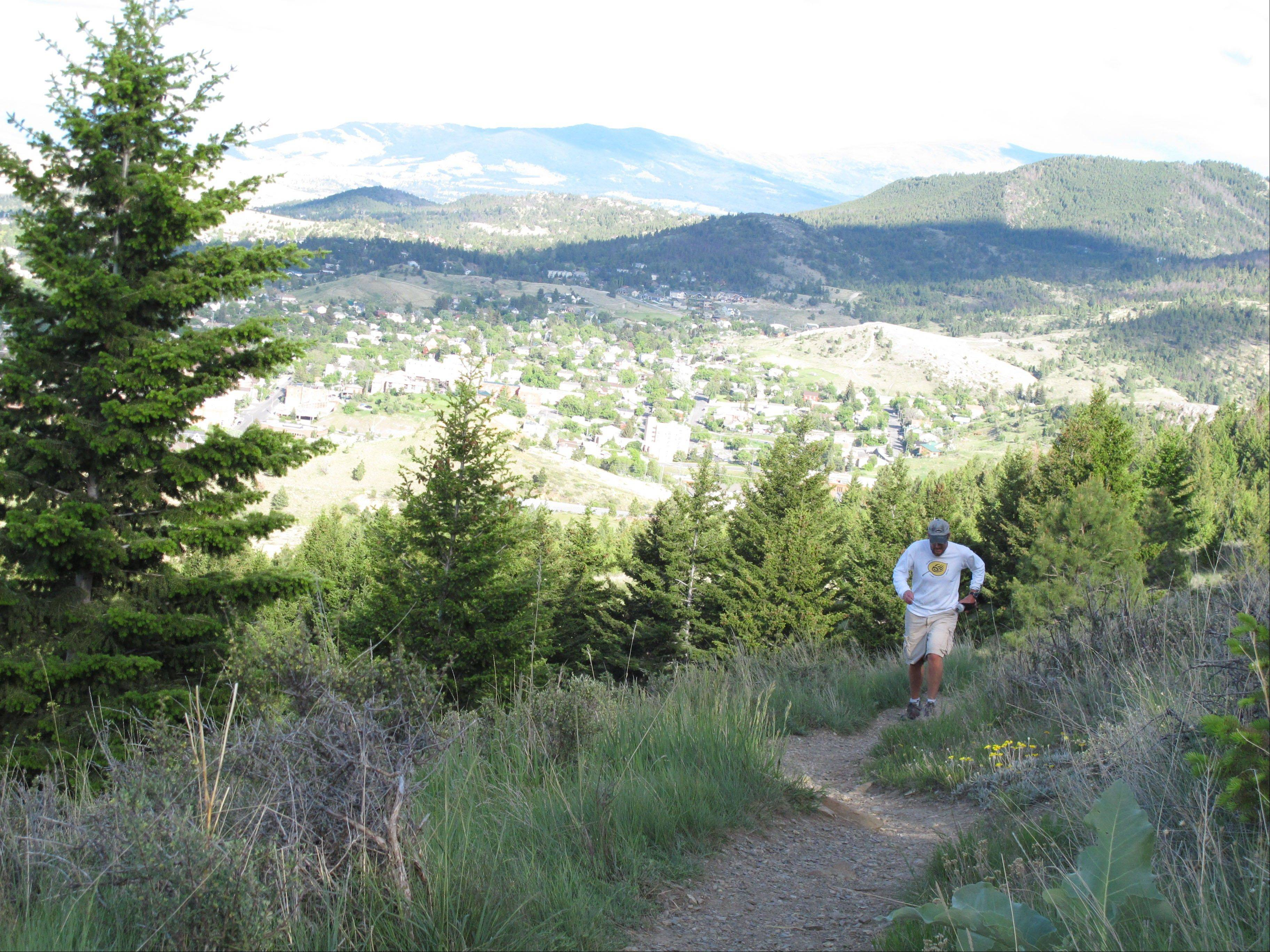 A jogger runs along a trail on Mount Helena. The Helena Ridge Trail, which ends at the 5,400-foot summit of Mount Helena, is one of the Montana capital's top attractions.