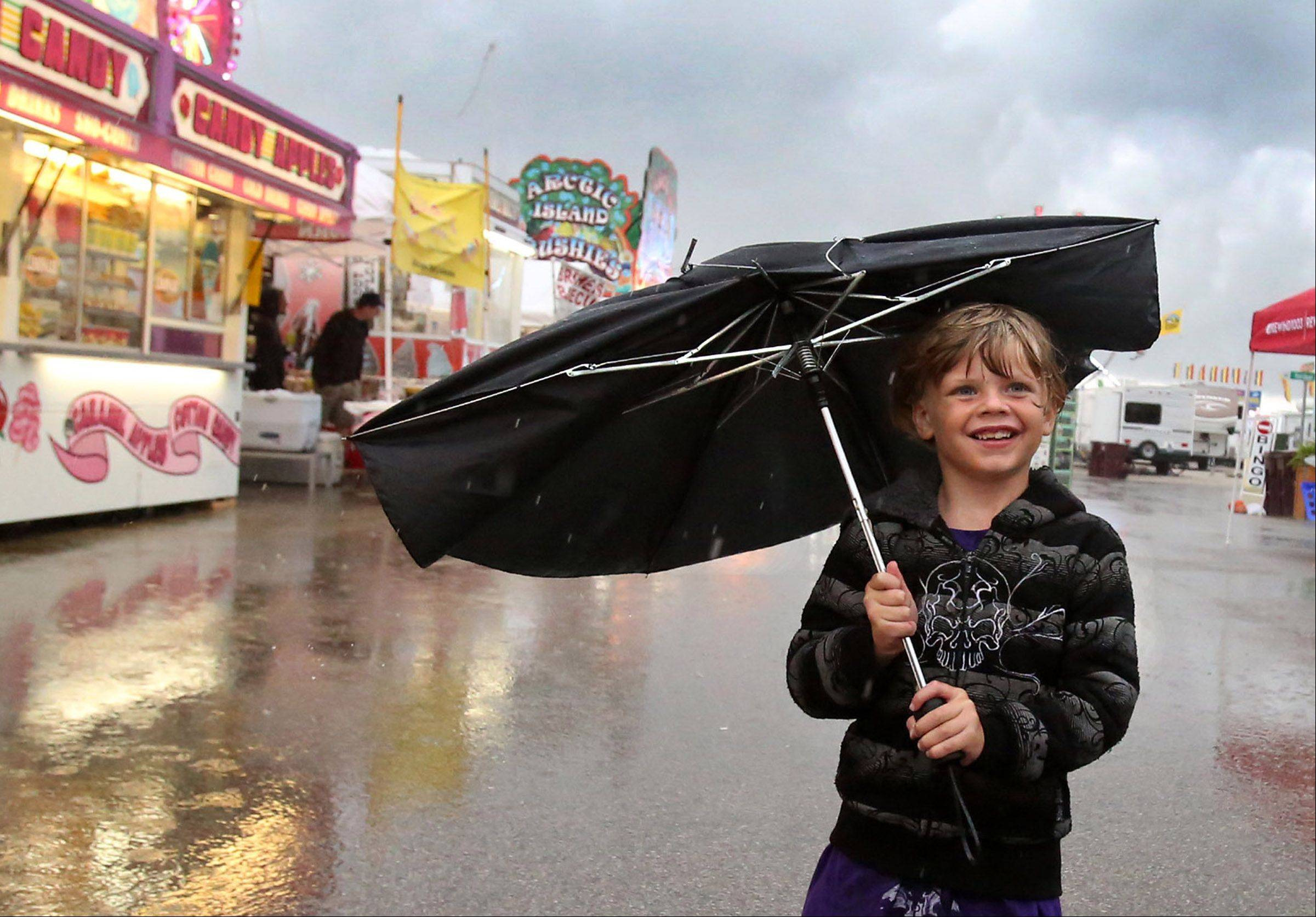 The umbrella of Tristan Benson, 9, of Antioch inverts from a wind gust.