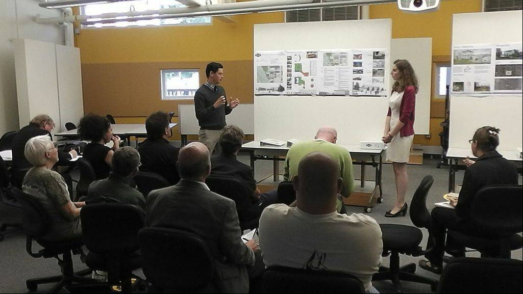 Judson University architecture graduate students Heather Tricoli and Josh Patterson present their study of the Hemmens Cultural Center in Elgin at a meeting on Thursday at the university.