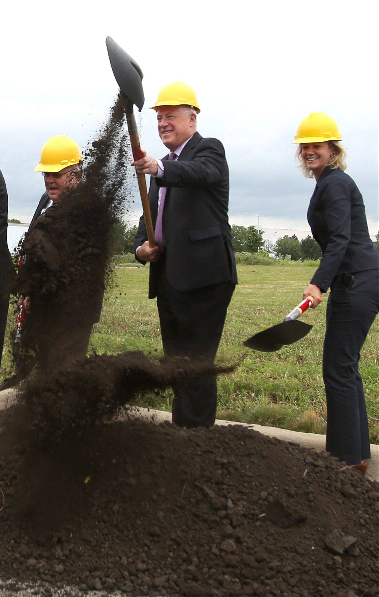 Gov. Pat Quinn and 42nd District state Rep. Jeanne Ives help break ground on a new $1.18 million environmental collection center in Naperville, which will benefit from $900,000 in state funding Quinn announced Friday.