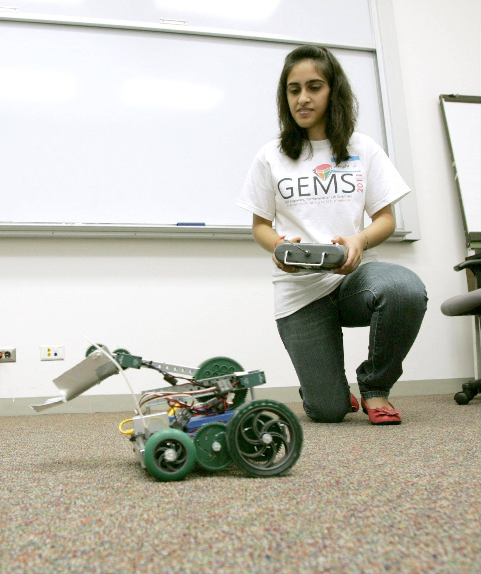 Aneysha Bhat of Neuqua Valley High School navigates her school's varsity robot during the second annual GEMS summer workshop for Girl Engineers Mathematicians and Scientists in 2011. The fourth annual workshop, scheduled for 12:30 to 4:30 p.m. Wednesday, Aug. 7, at Naperville Central High School, features 17 panelists in physics, biology/medicine, technology and engineering/design.