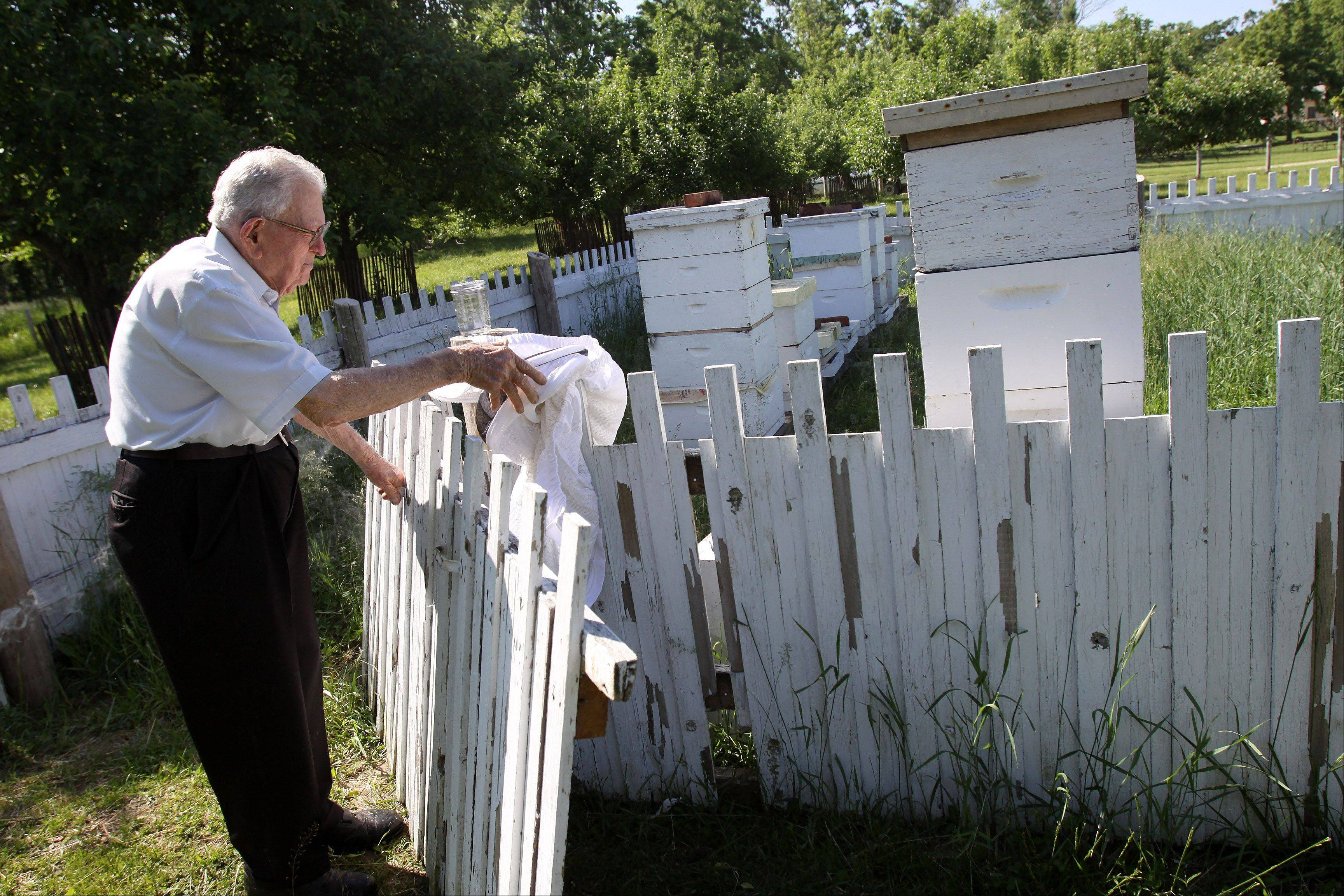 DuBose gets ready to tend to the bees at Kline Creek Farm in Winfield.