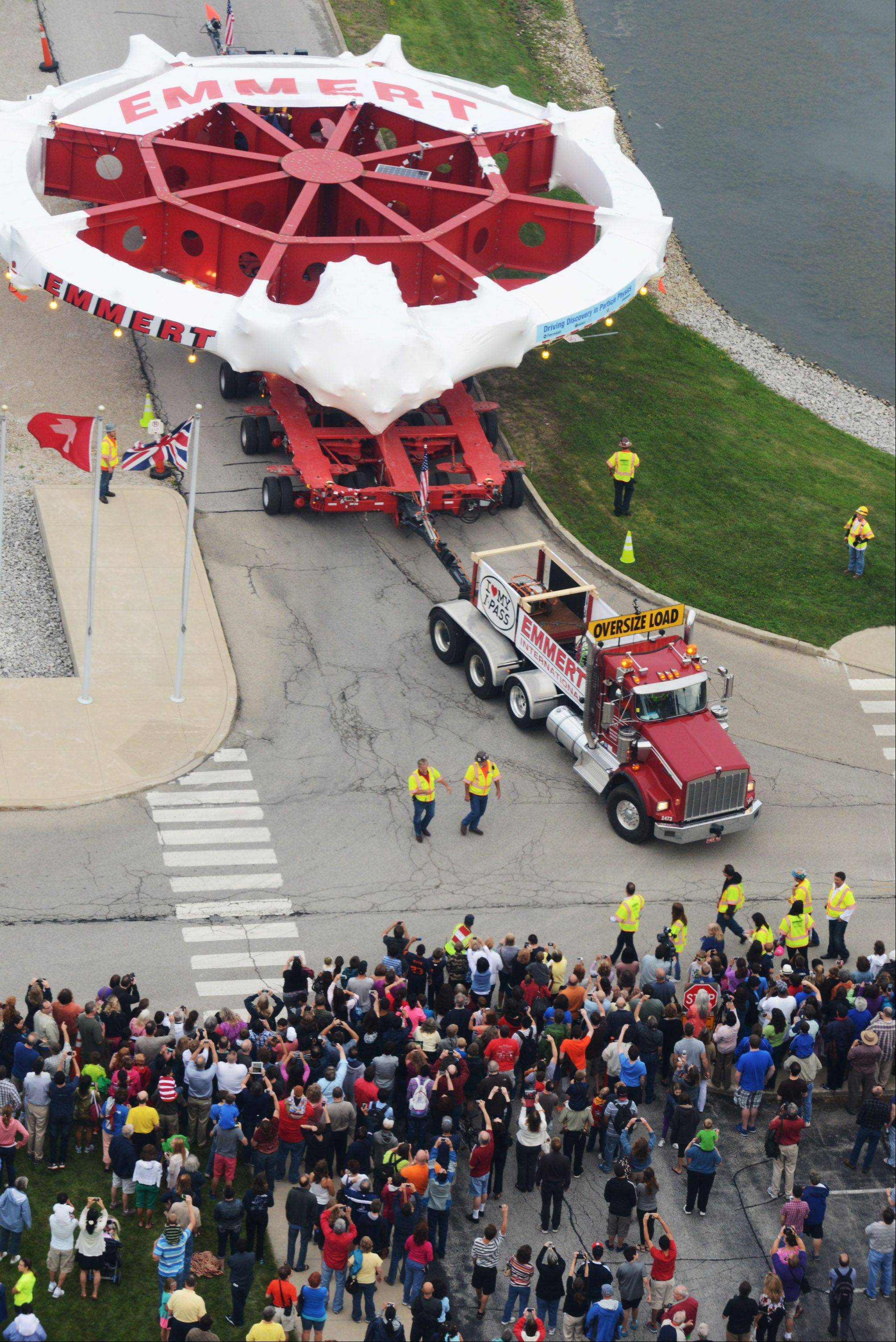 Emmalee Luckas/eluckas@dailyherald.comThe Mugon g-2 superconducting electromagnet ends its journey Friday, July 26 at Fermilab with a large crowd celebrating its arrival. Many people watched the electromagnet drive up to Wilson Hall from the fifteenth floor.