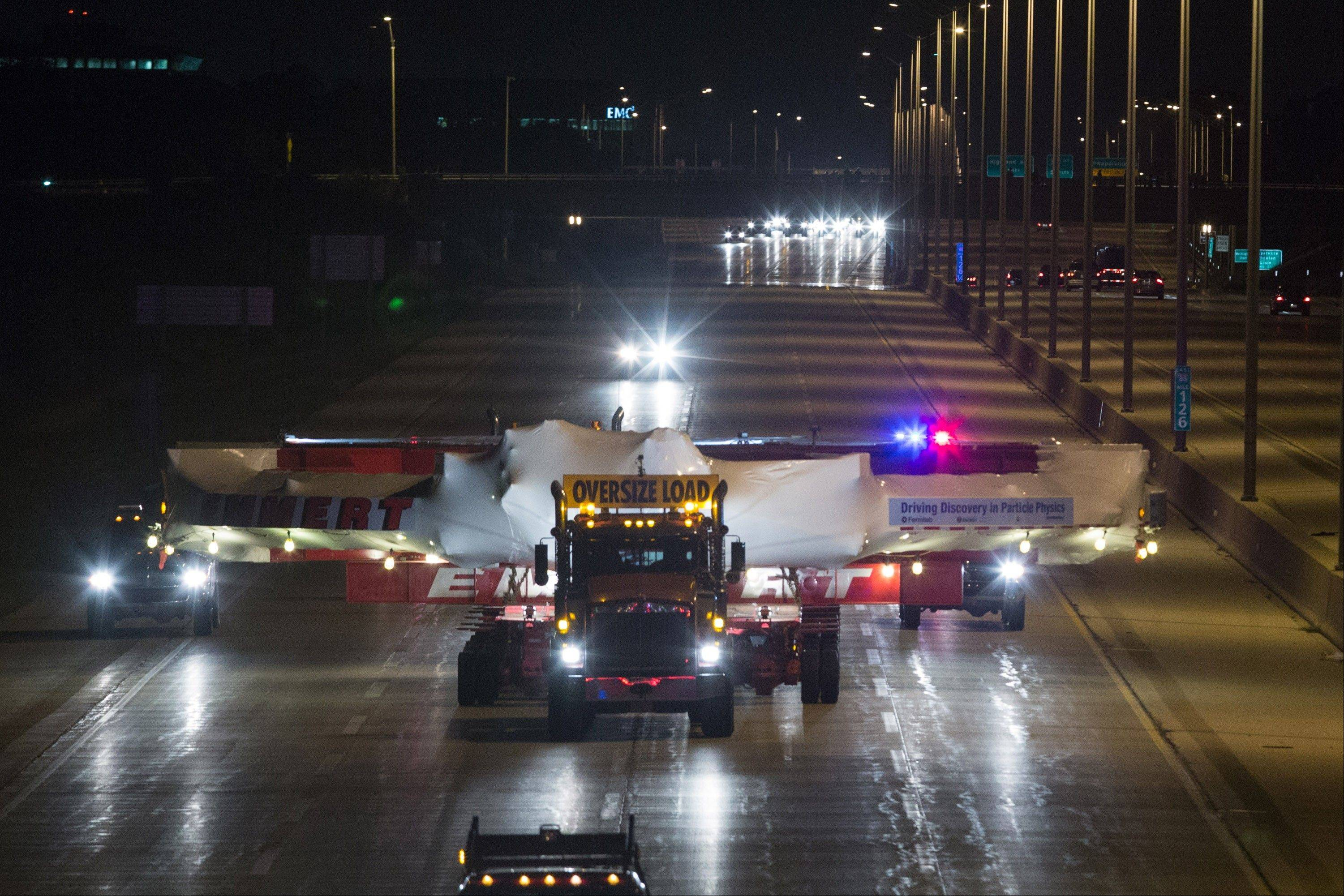 The electromagnet moves down Interstate 88 in Naperville, Ill., Friday.