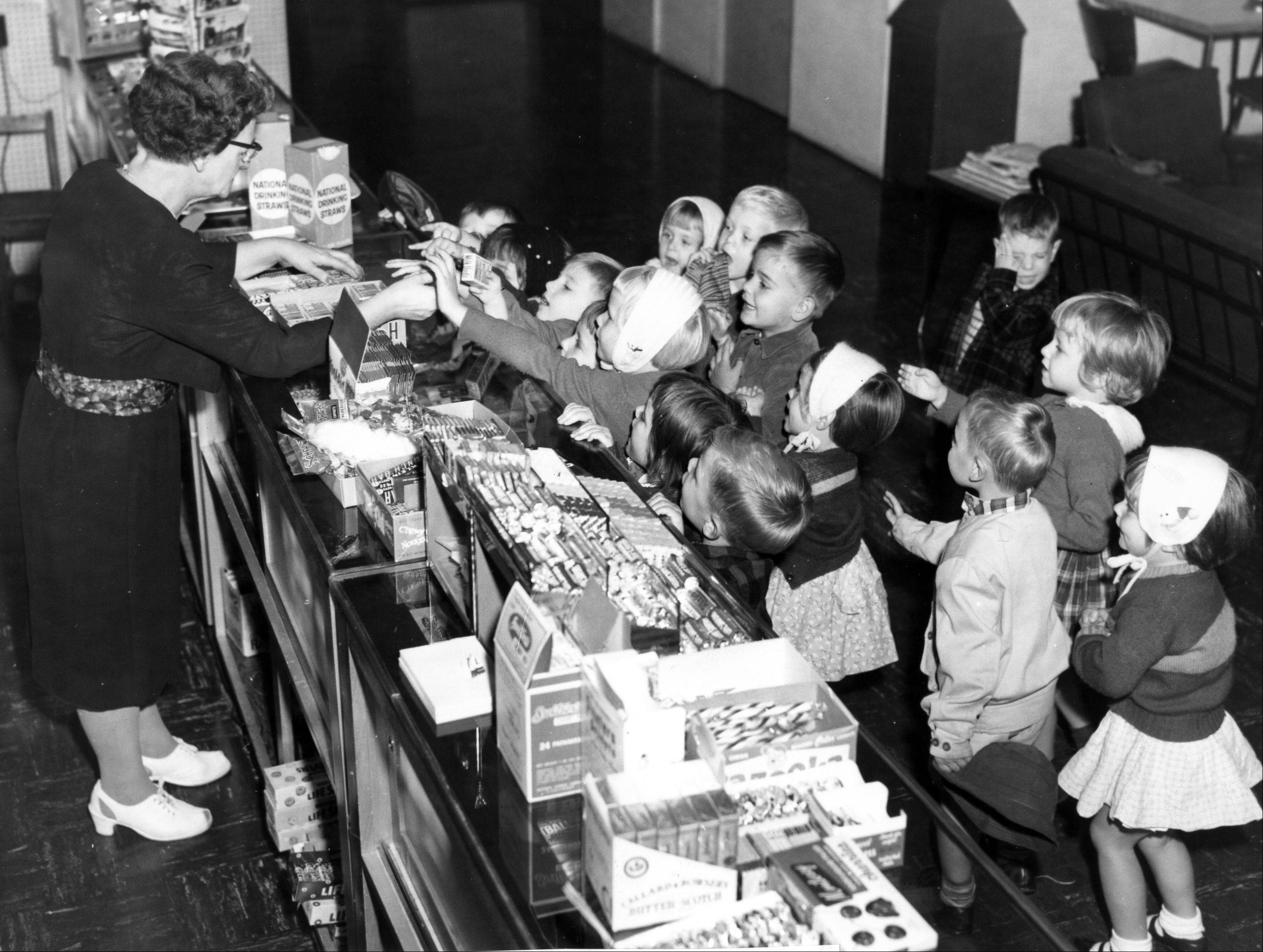 Mooseheart students, circa 1950, shop for candy at the commissary.
