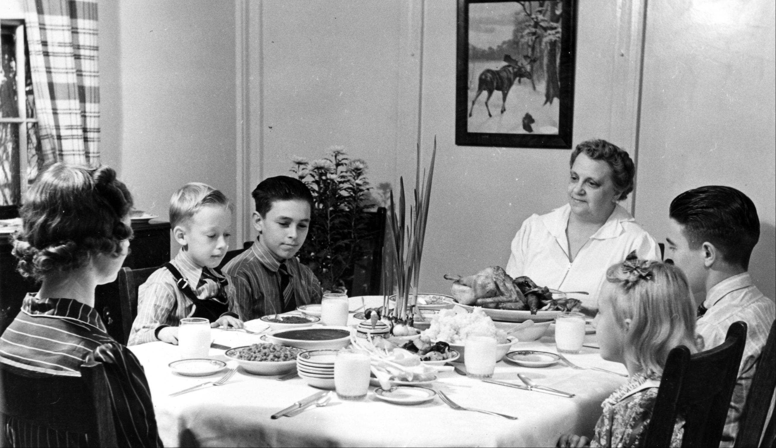Children enjoy a Thanksgiving Day dinner in a home at Mooseheart in the 1950s. Either the boys or the girls were guests, because the family homes were single-sex.