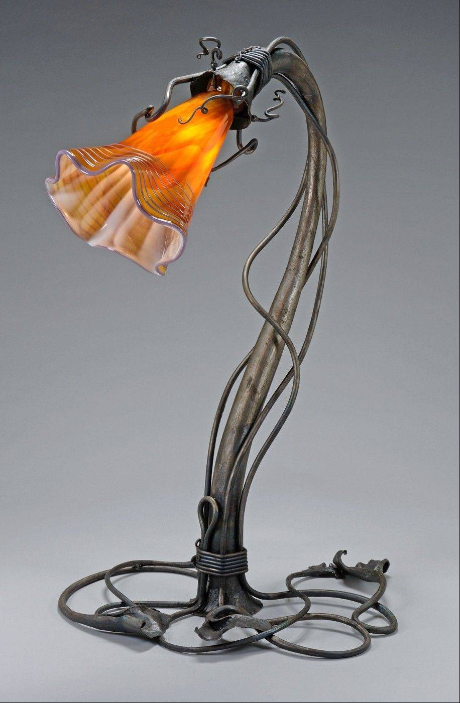 La Waltz, a forged iron sculpture and functional art lamp, is an example of the type of work Roberta Elliott will be showing at the Geneva Arts Fair.
