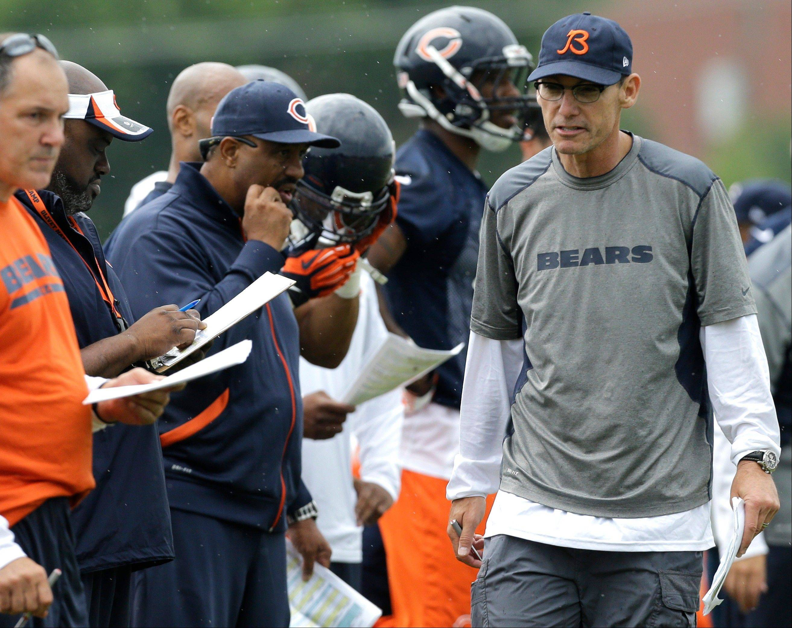 Chicago Bears head coach Marc Trestman, right, talks to coaching staff during training camp Friday at Olivet Nazarene University in Bourbonnais.