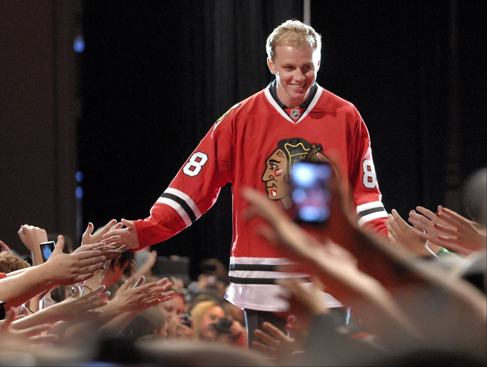Patrick Kane runs the gauntlet of fans after being introduced at the sixth annual Blackhawks Convention.