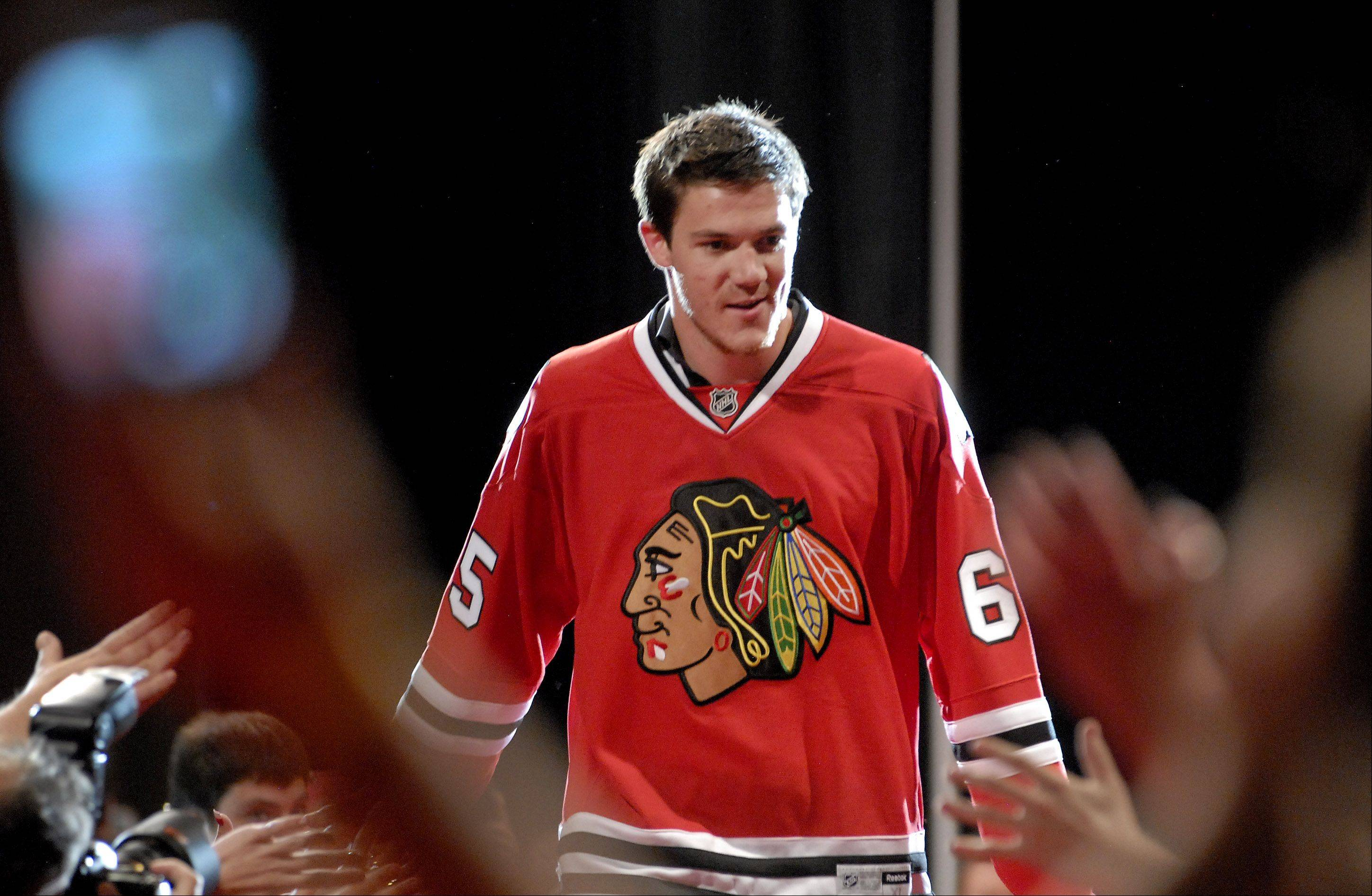 Andrew Shaw runs the gauntlet of fans.
