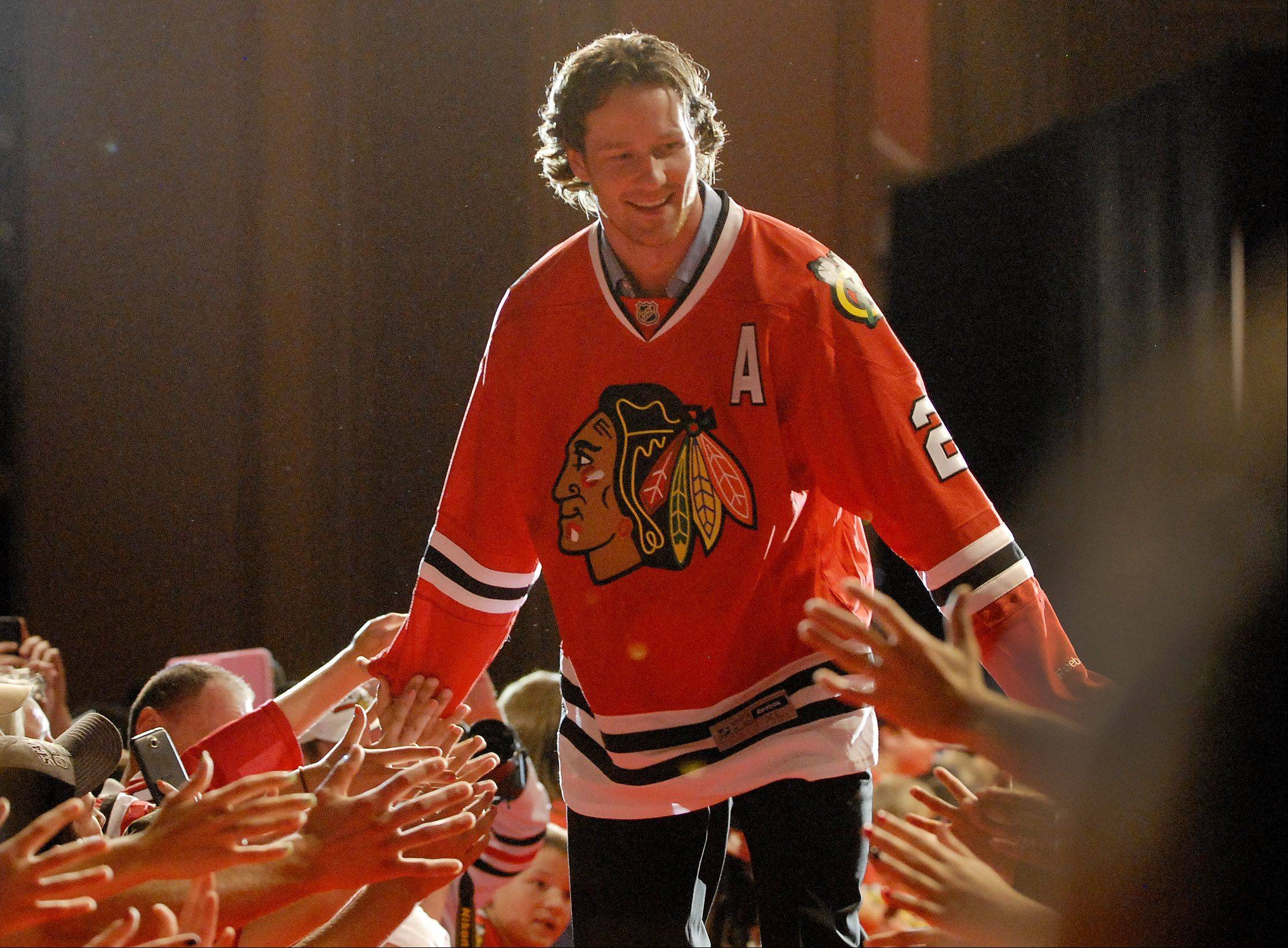 Duncan Keith is greeted by a sea of hands.
