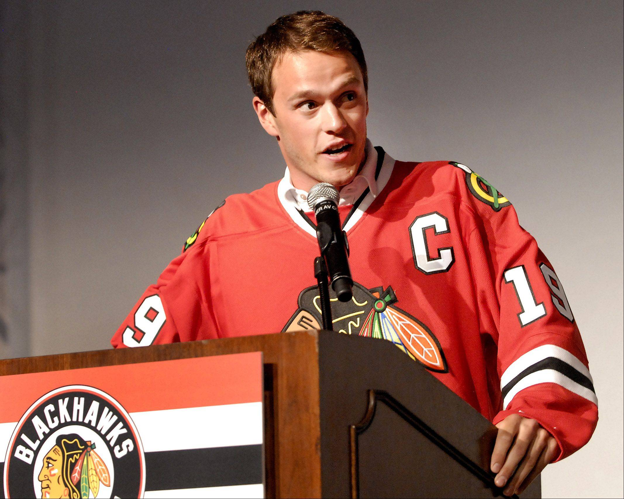 Jonathan Toews makes some opening remarks.