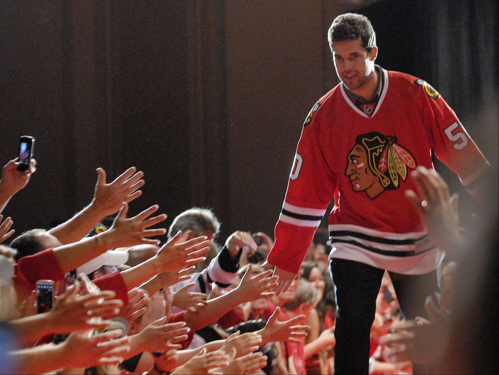Corey Crawford is introduced.