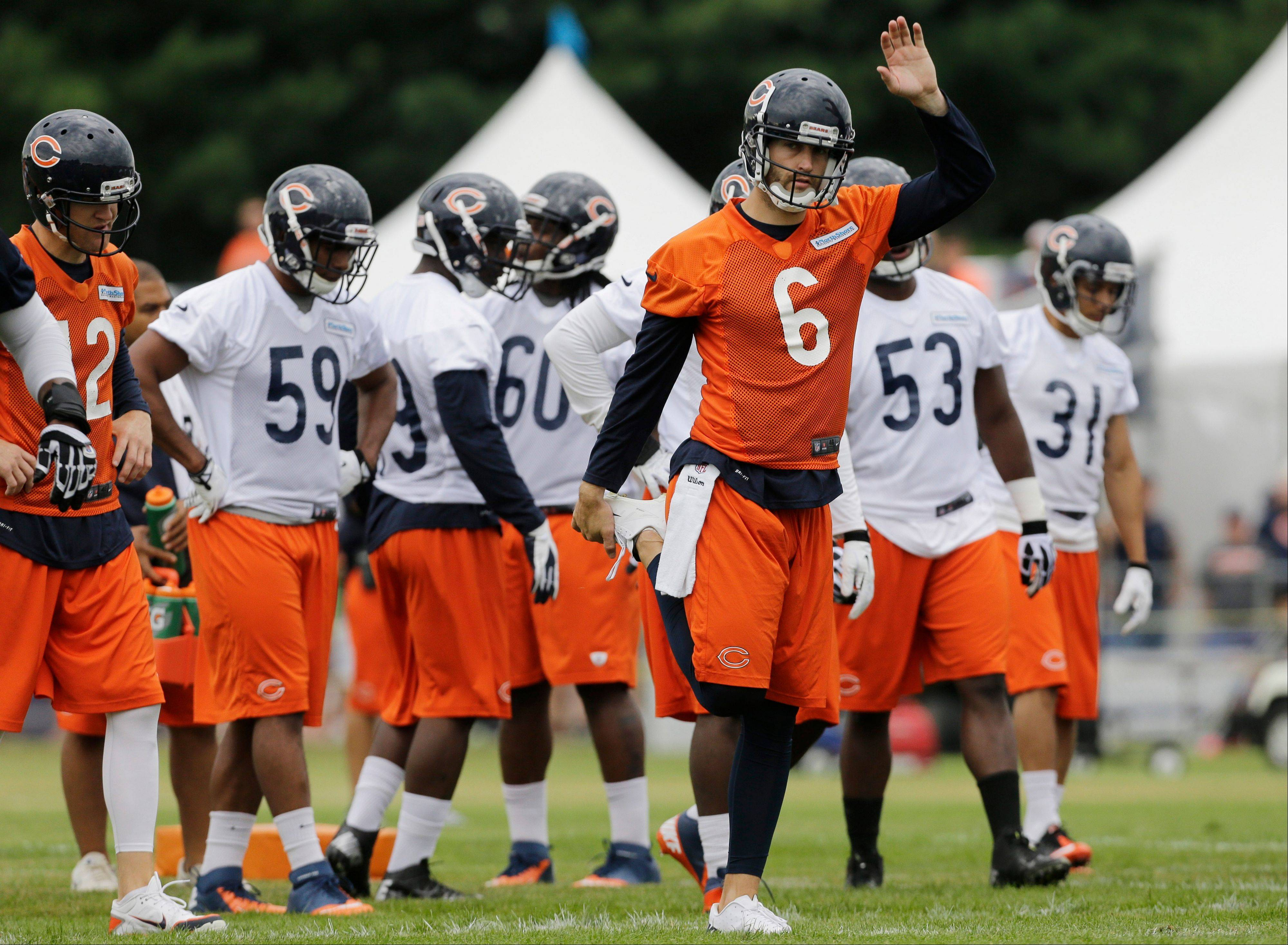 Chicago Bears quarterback Jay Cutler stretches.
