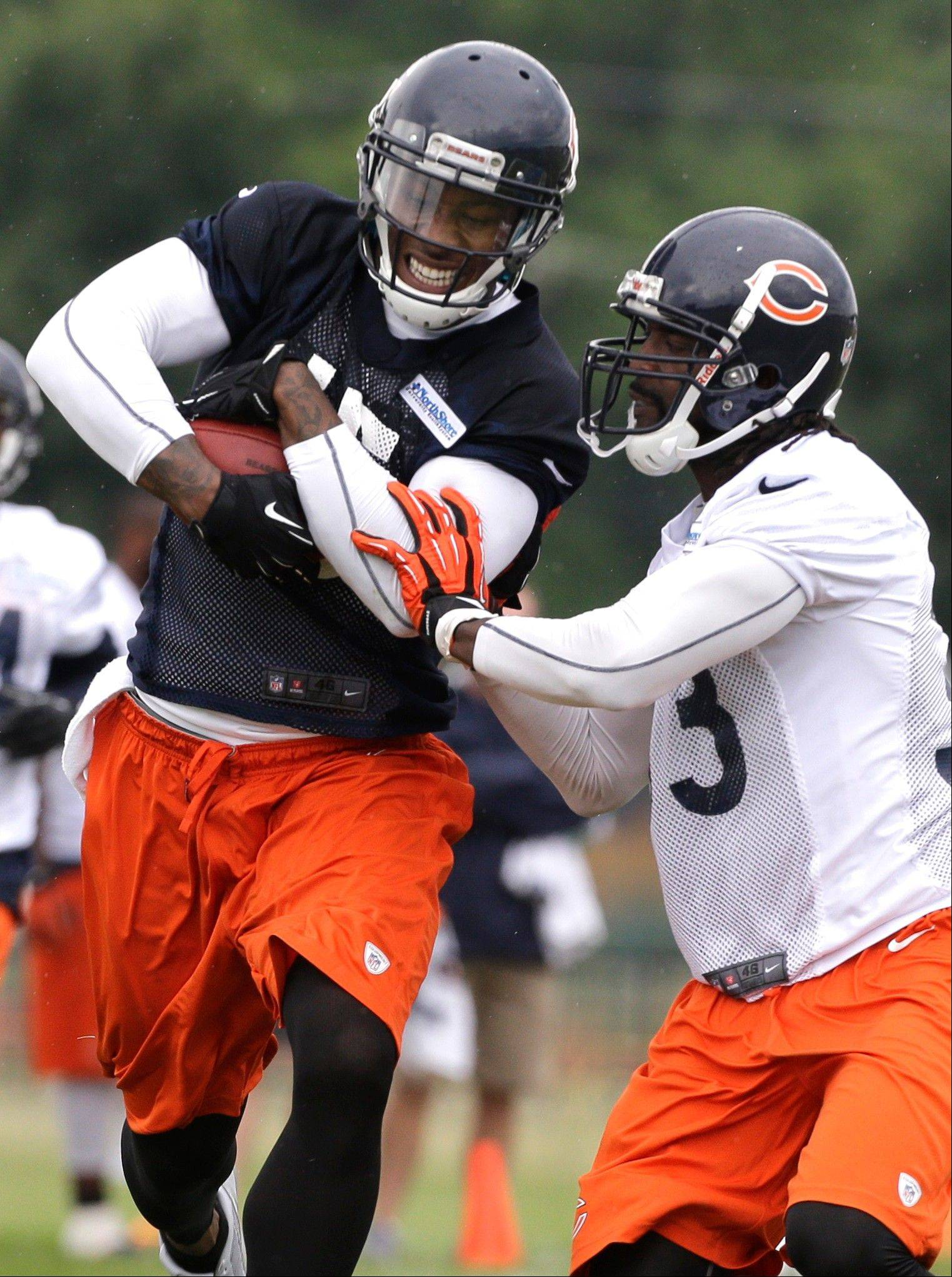 Chicago Bears wide receiver Brandon Marshall, left, runs with a ball against cornerback Charles Tillman.