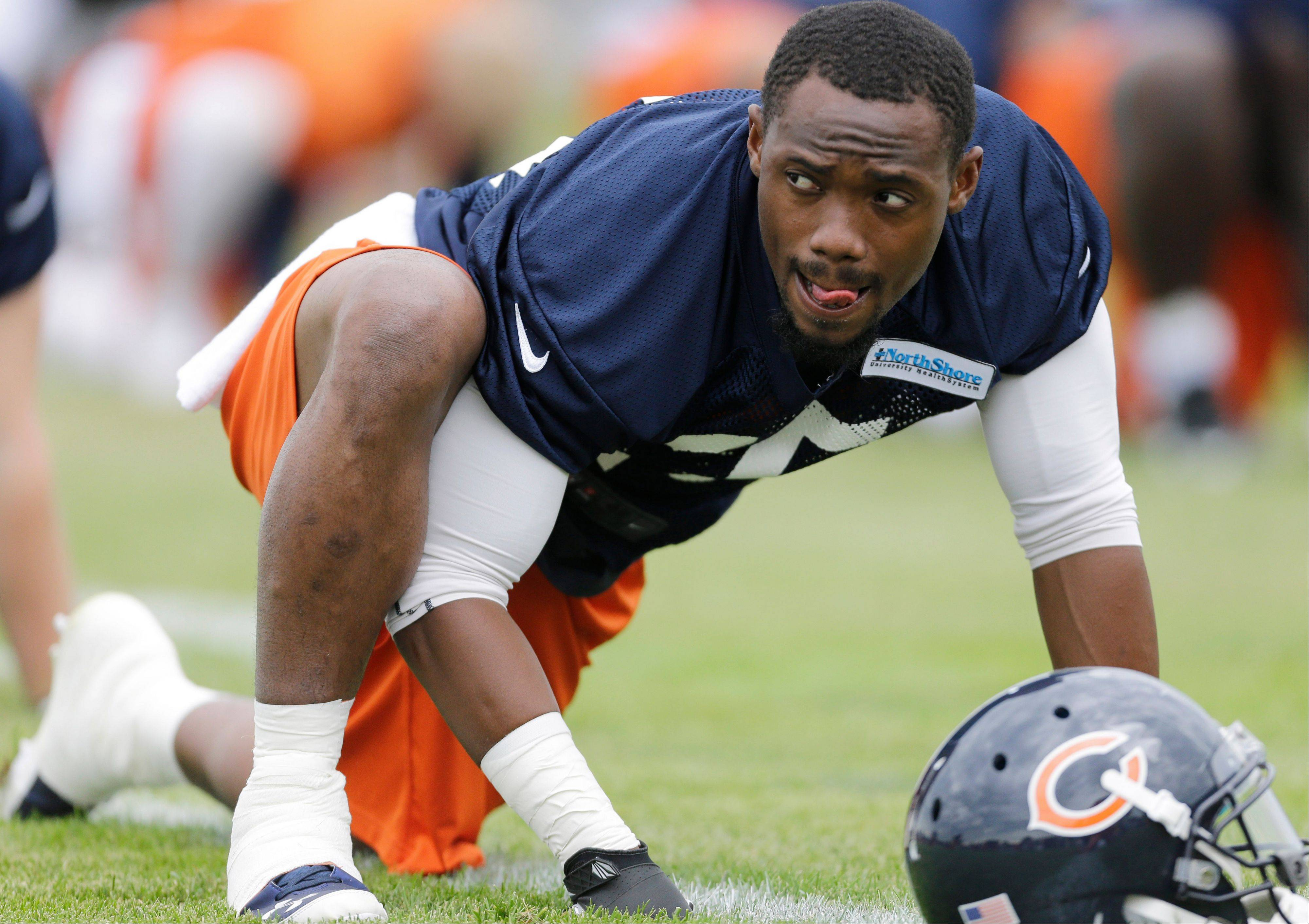 Chicago Bears running back Armando Allen stretches.