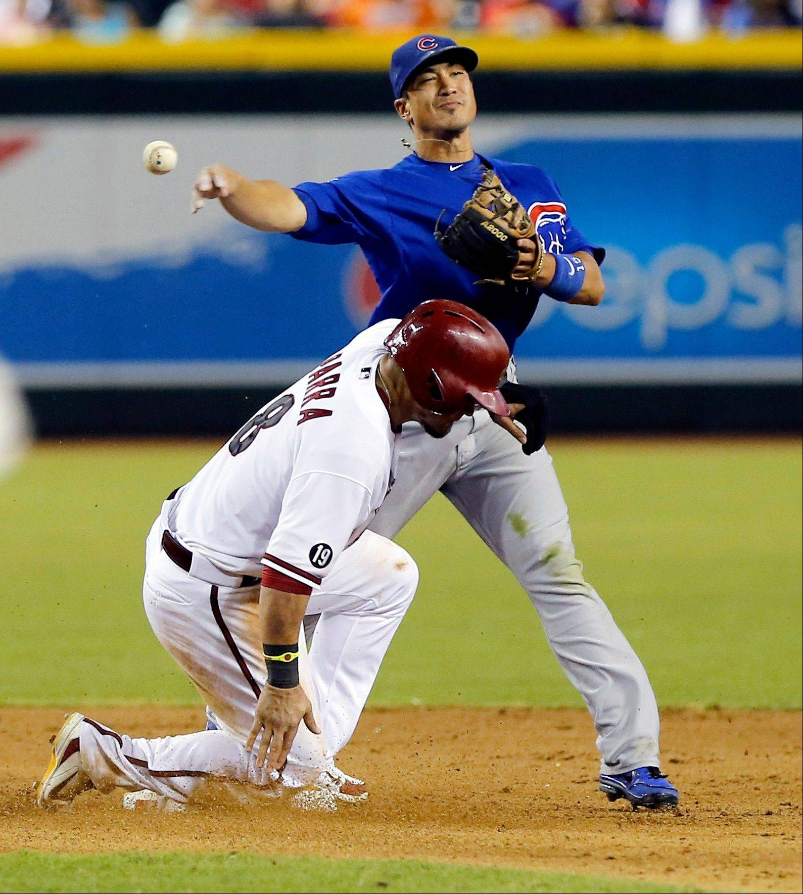 Arizona Diamondbacks' Gerardo Parra is forced out by Chicago Cubs' Darwin Barney as he throws out Wil Neives Thursday night in Phoenix. The Cubs lost 3-1.
