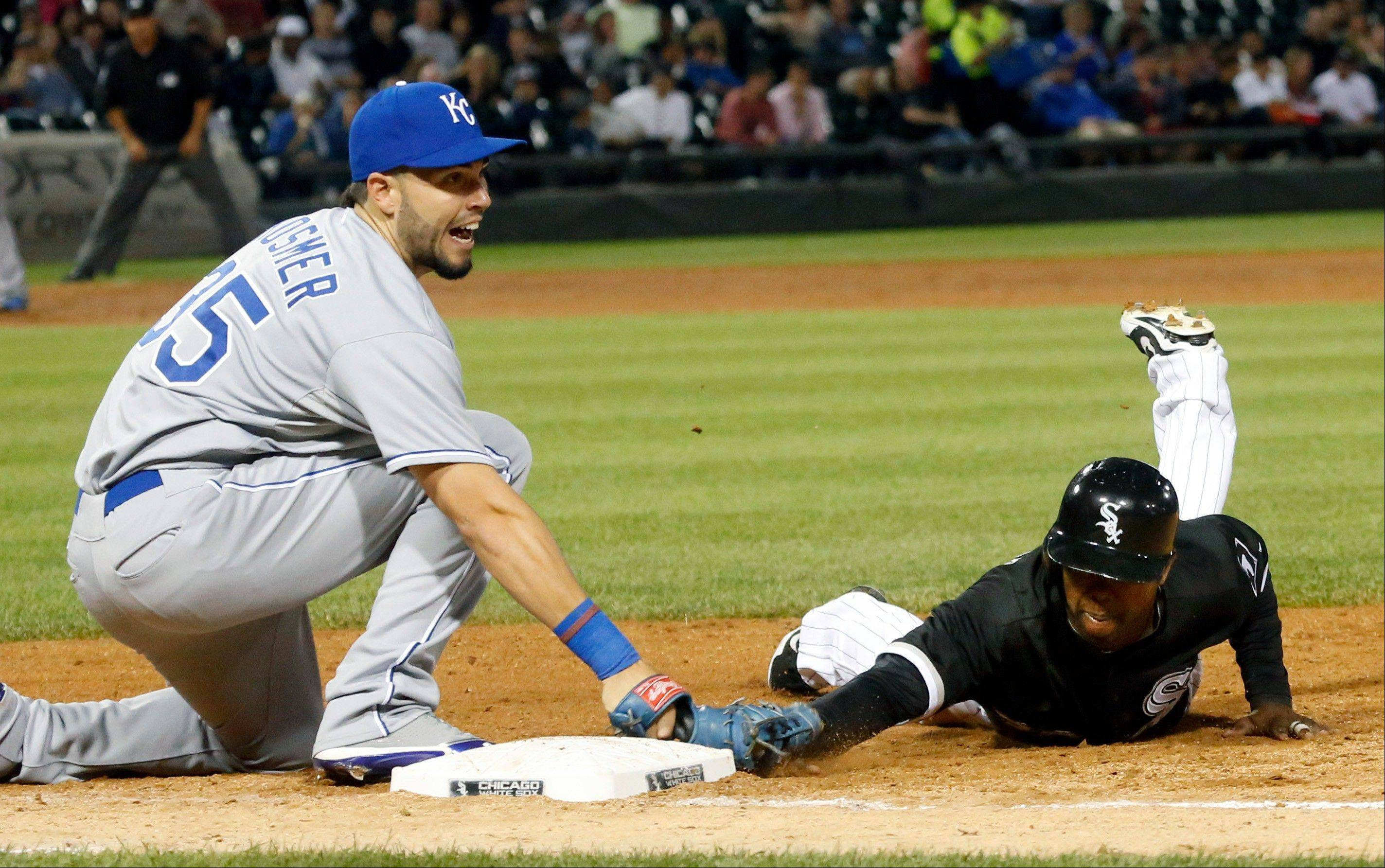 Kansas City Royals first baseman Eric Hosmer (35) looks toward first base umpire Manny Gonzalez as he picks off Chicago White Sox's Alejandro De Aza, right, on a throw from starting pitcher James Shields during the fifth inning of a baseball game on Friday, July 26, 2013, in Chicago.